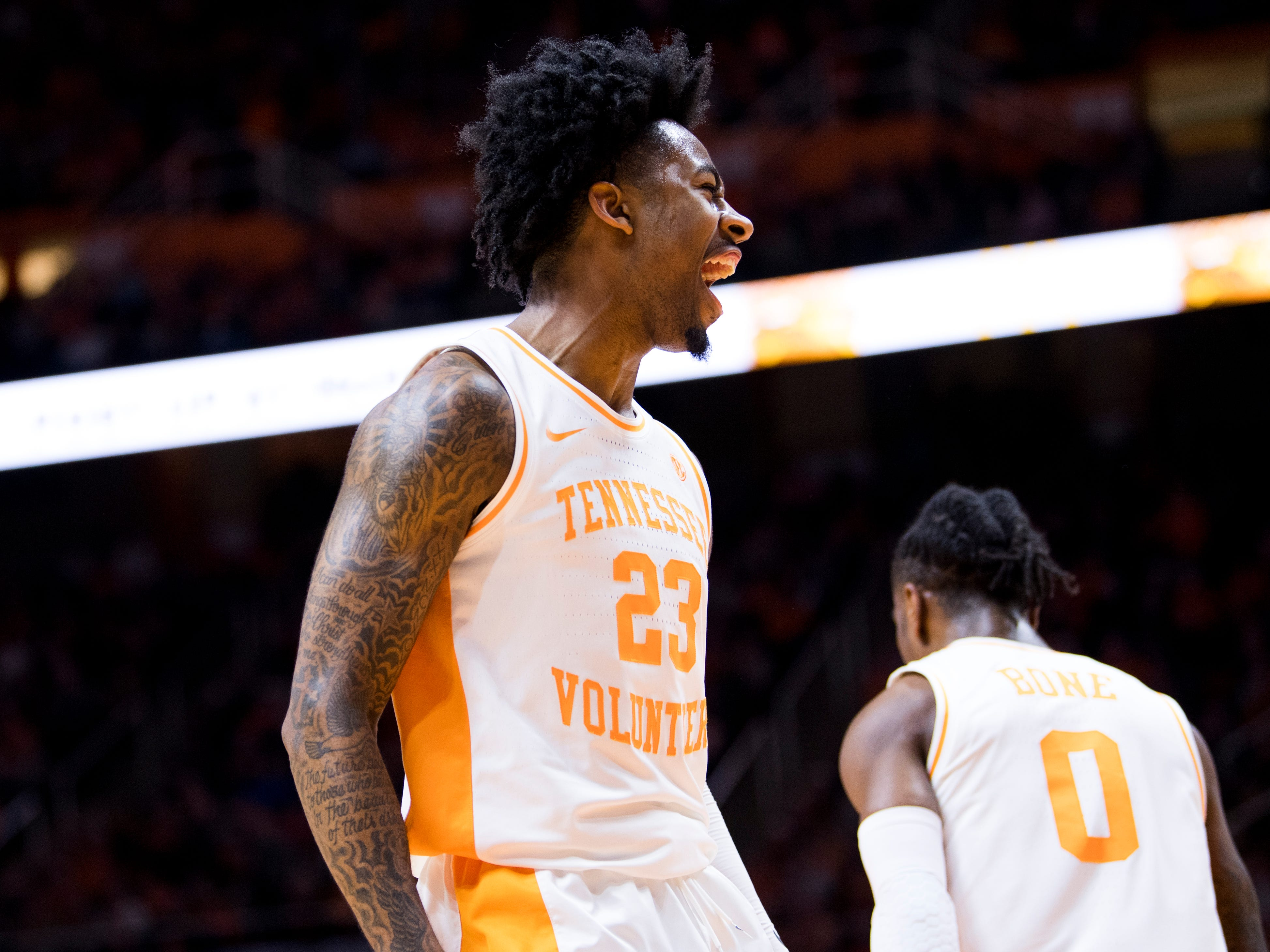 Tennessee guard Jordan Bowden (23) celebrates a dunk by Tennessee guard Jordan Bone (0) during Tennessee's home SEC game against South Carolina at Thompson-Boling Arena in Knoxville on Wednesday, February 13, 2019.