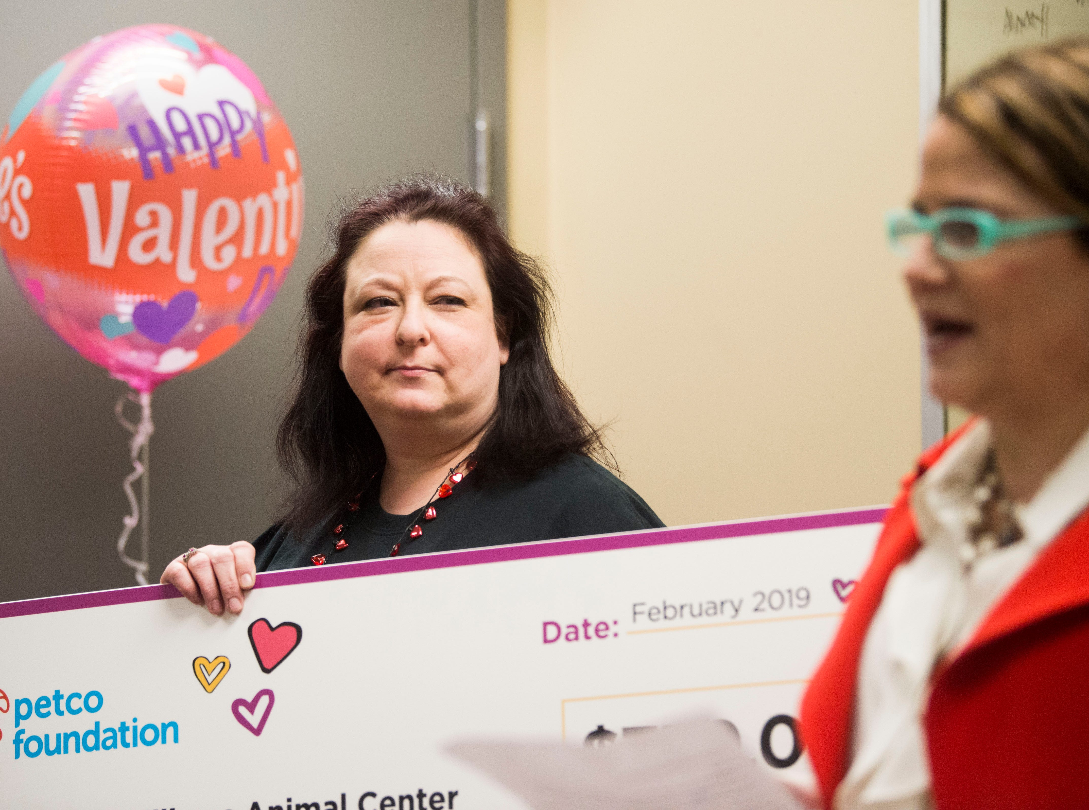Amy Harville, store manager of the Bearden Petco location, presents a check at Young-Williams Animal Center in Knoxville Thursday, Feb. 14, 2019. The animal shelter received a surprise $750,000 grant from the Petco Foundation.Ê