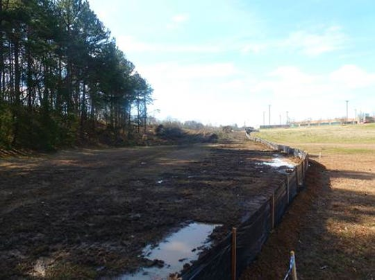 Clearing operations begin on the west side of Alcoa Highway.