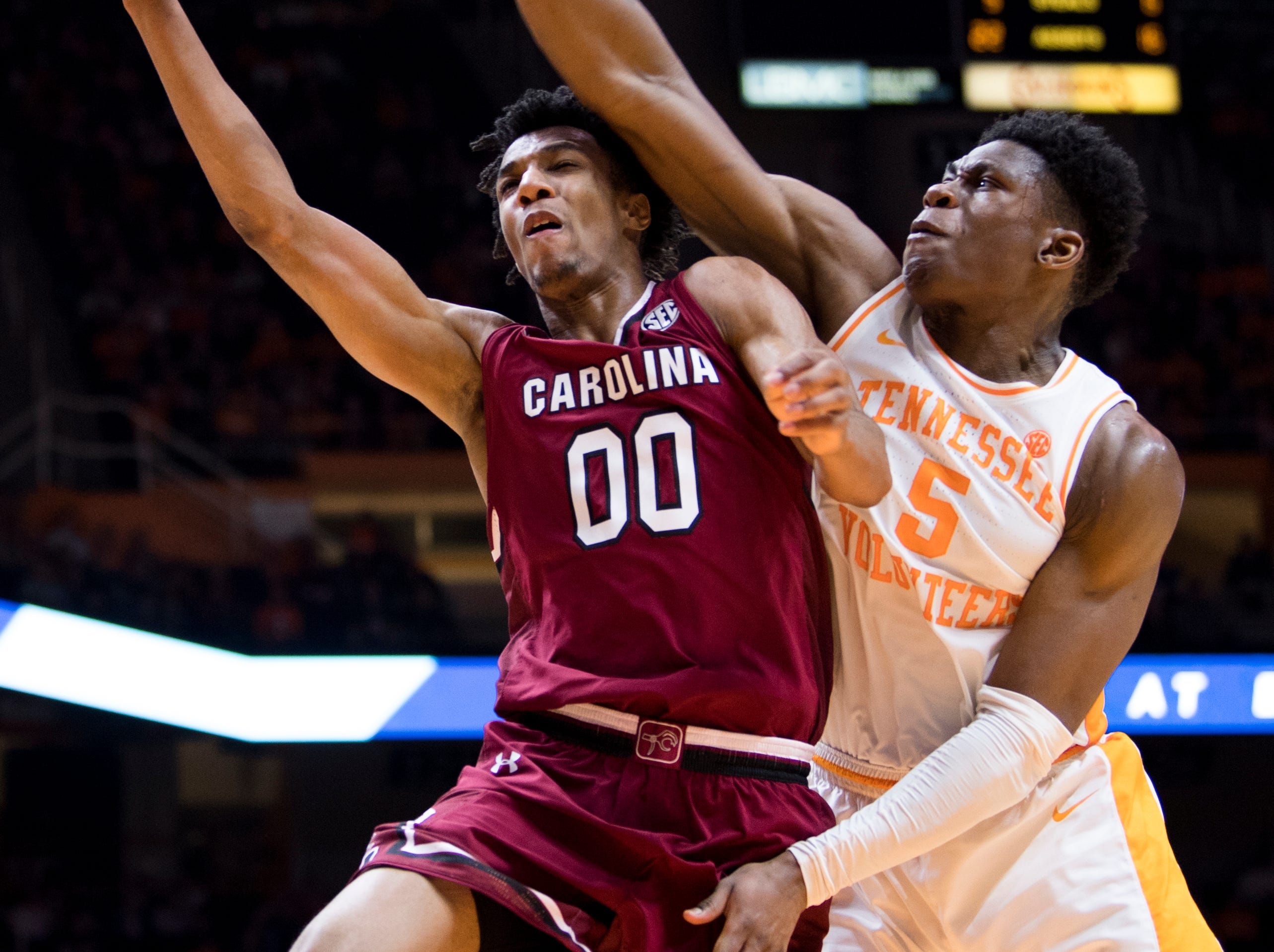Tennessee guard Admiral Schofield (5) blocks a shot by South Carolina guard A.J. Lawson (0) during Tennessee's home SEC game against South Carolina at Thompson-Boling Arena in Knoxville on Wednesday, February 13, 2019.