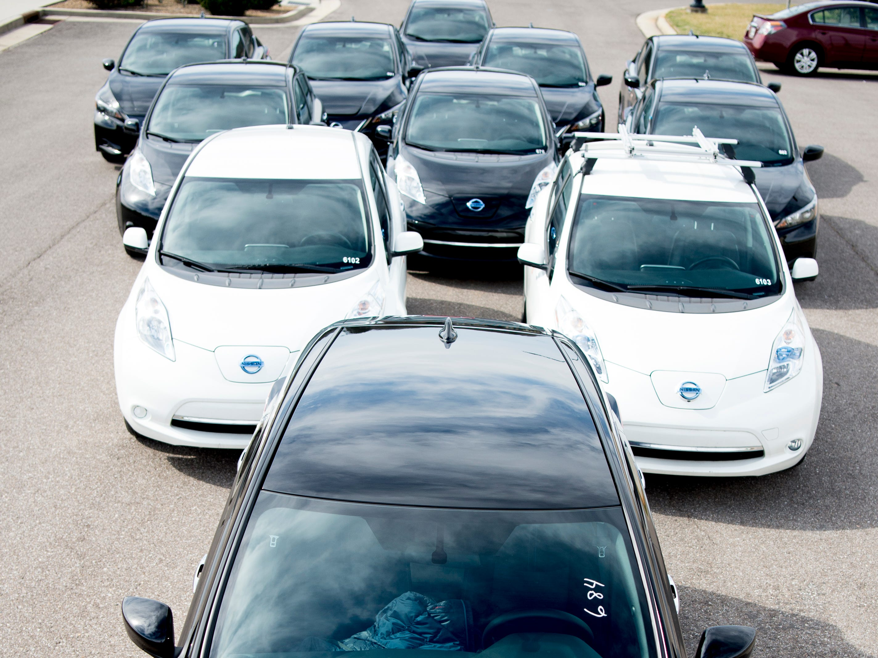 The 11-car fleet of Nissan Leaf electric vehicles owned by the University of Tennessee photographed at Cherokee Farm campus in Knoxville, Tennessee on Thursday, February 14, 2019. UT has a fleet of 11 Nissan Leaf electric vehicles and is expecting to grow the fleet's size over the coming years.