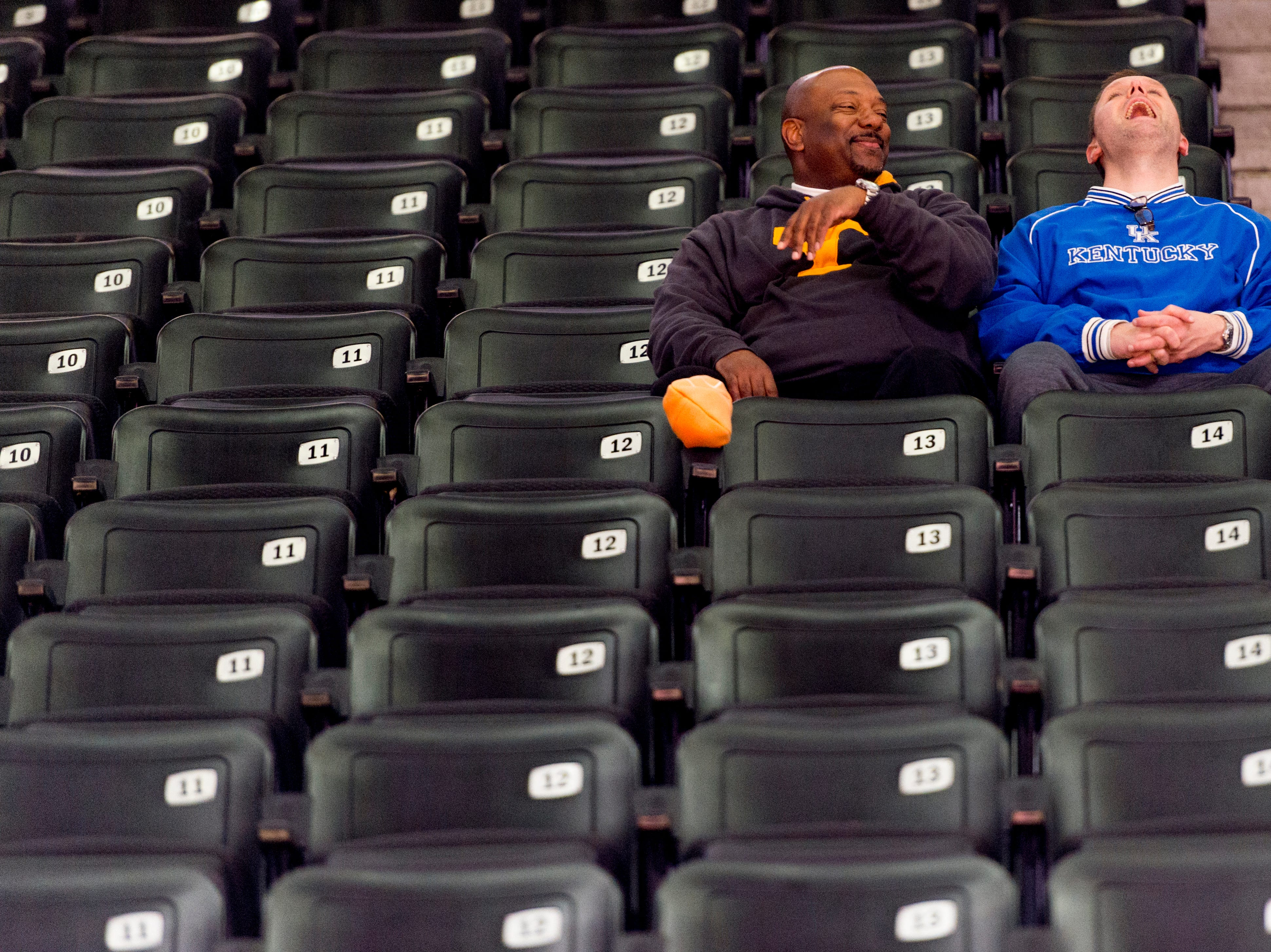 A Tennessee and Kentucky fan share a laugh during a game between Tennessee and Kentucky at Thompson-Boling Arena in Knoxville, Tennessee on Saturday, January 6, 2018.