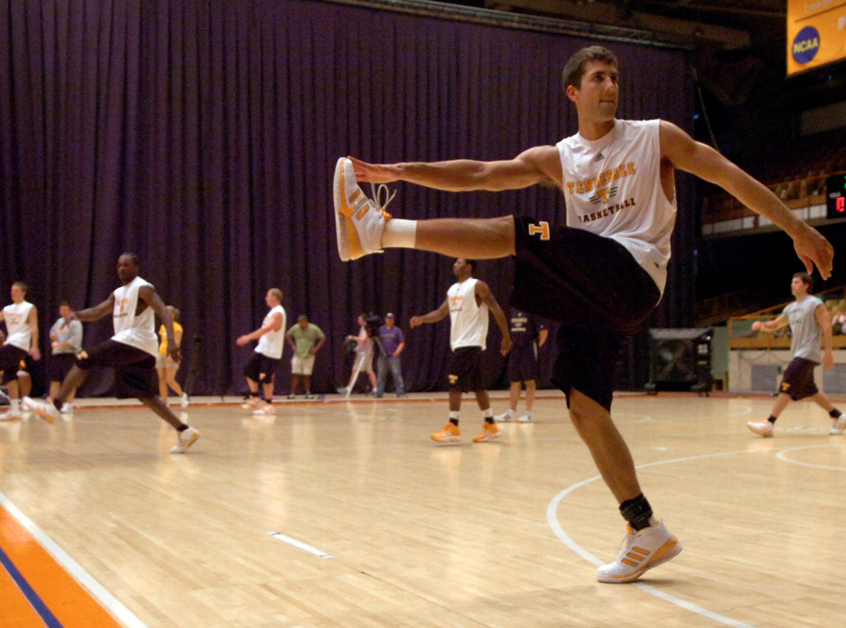 Tennessee basketball player Ryan Childress participates in stretching excercises during practice on Aug. 1, 2007, at Stokely Athletic Center.