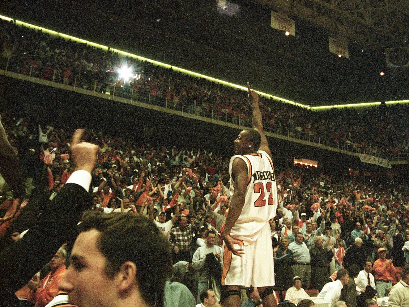 Tennessee's Vincent Yarbrough and Tony Harris signal to a sell out crowd at Thompson-Boling Arena in March 1999. Tennessee is the #1 team in the SEC East.