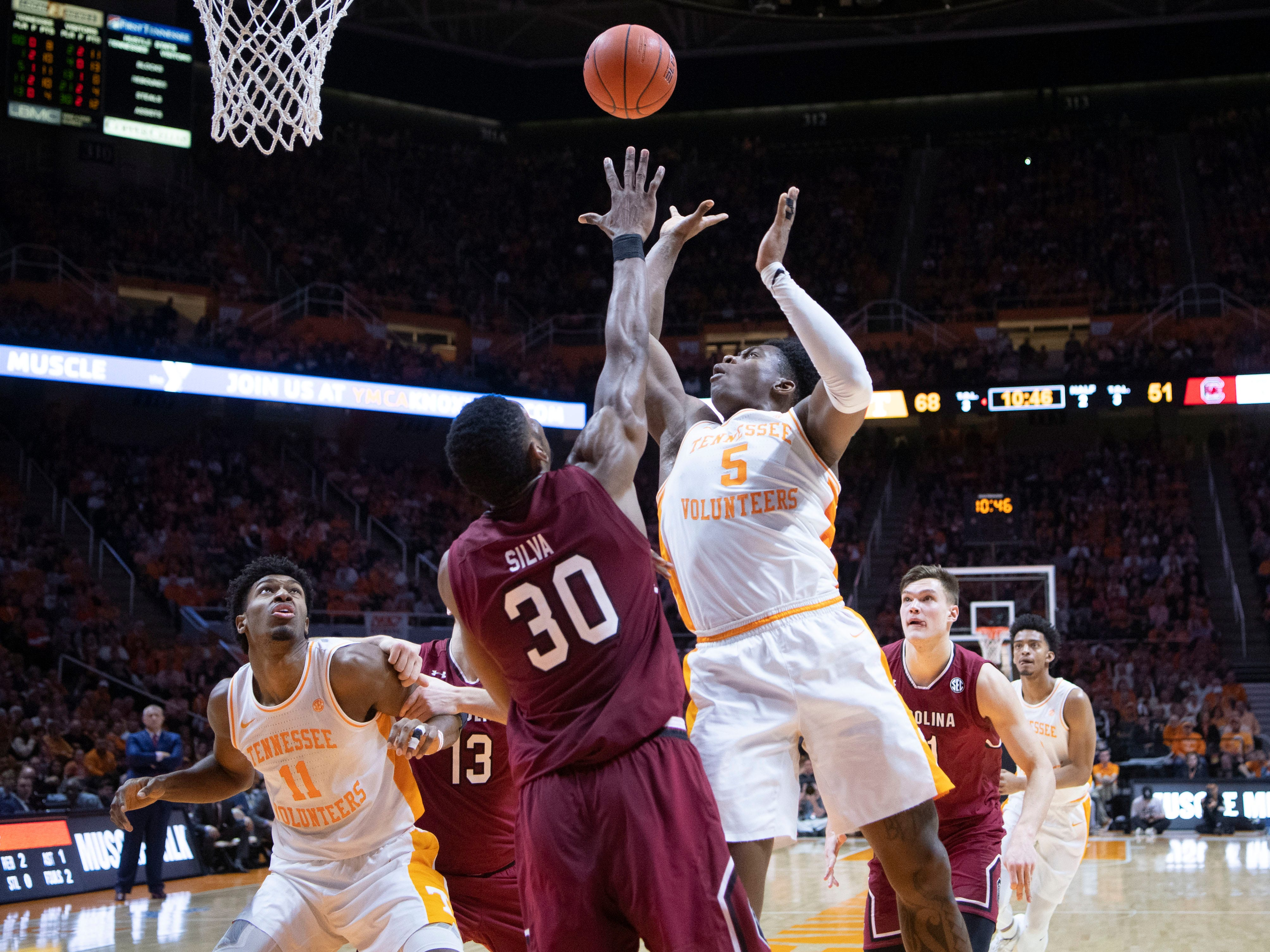 Tennessee's Admiral Schofield (5) takes a shot while guarded by South Carolina's Chris Silva (30) on Wednesday, February 13, 2019.