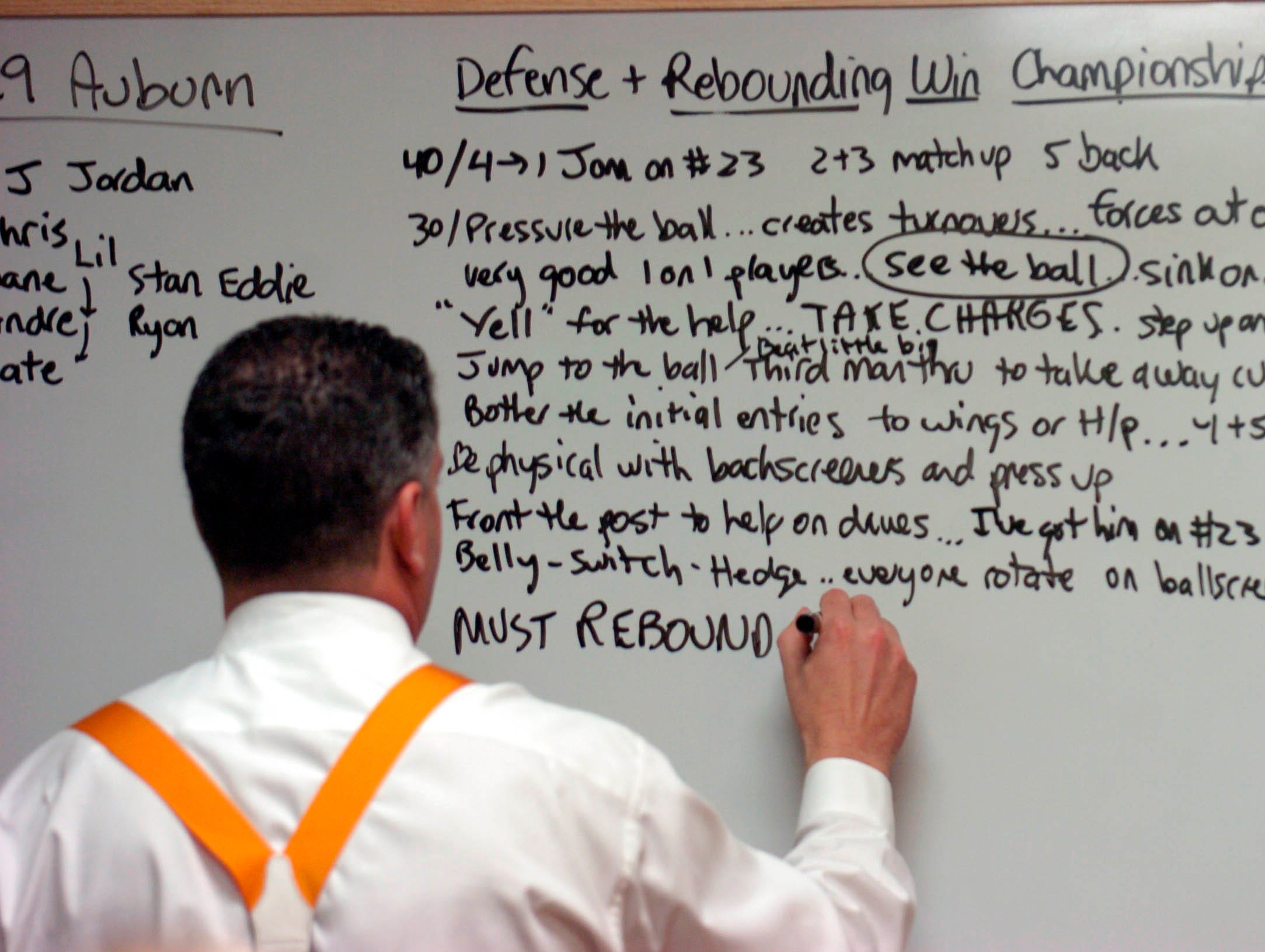 Tennessee basketball coach Bruce Pearl makes notes on the locker room board minutes before gametime. 2006