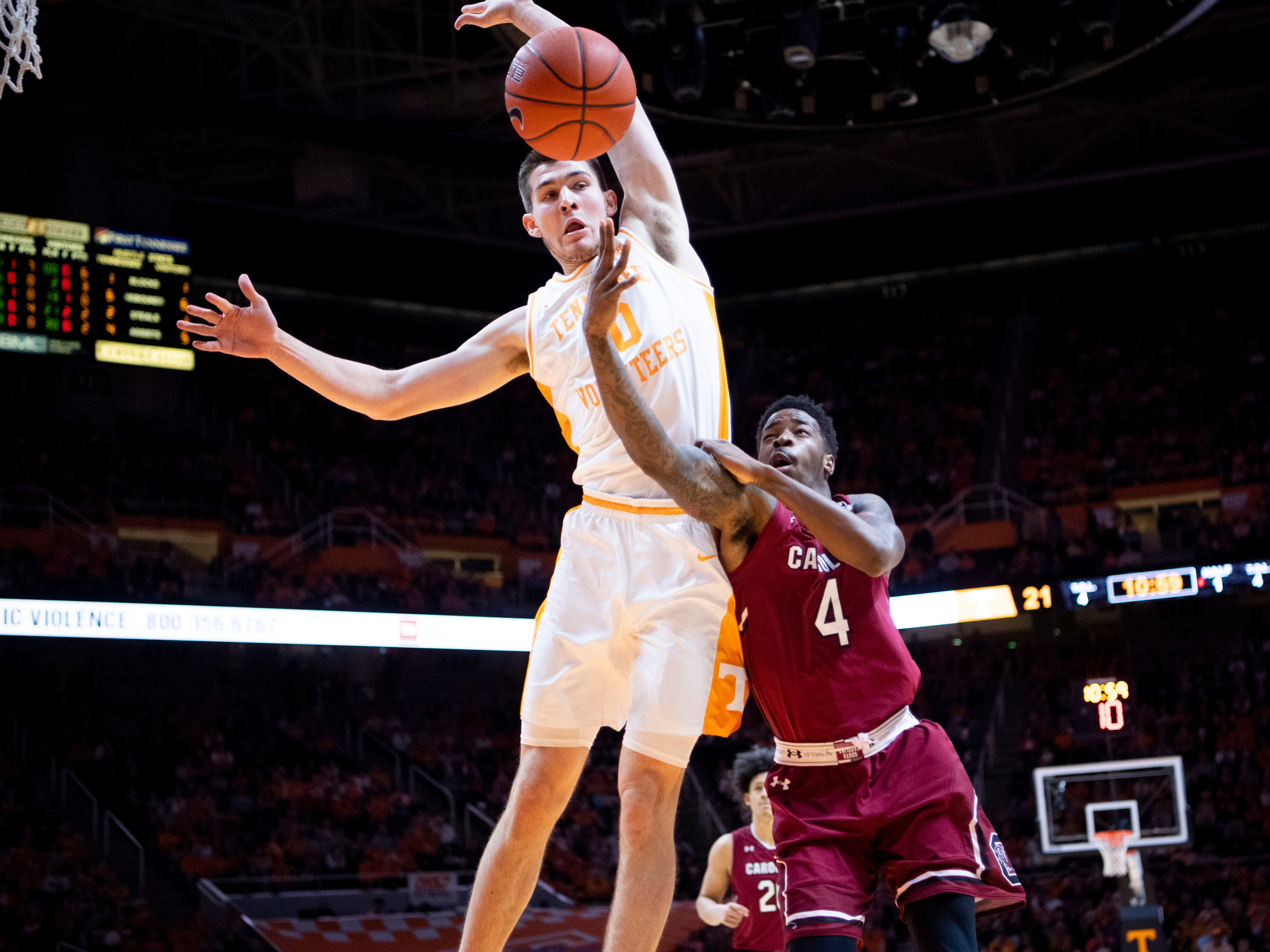 Tennessee's John Fulkerson (10) knocks away a shot attempt by South Carolina's Tre Campbell (4) on Wednesday, February 13, 2019.
