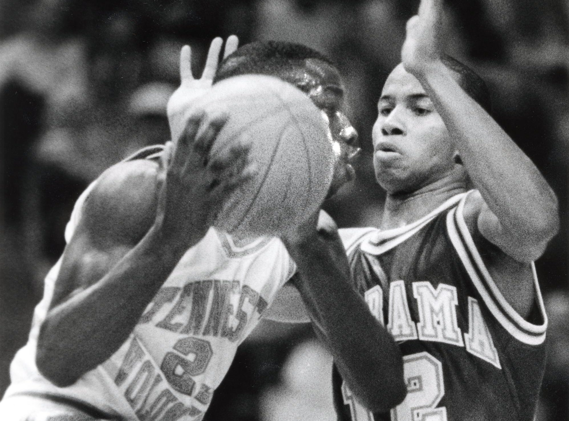 Alabama's Gary Waites sticks closely to Tennessee's Greg Bell during a game in February 1989.