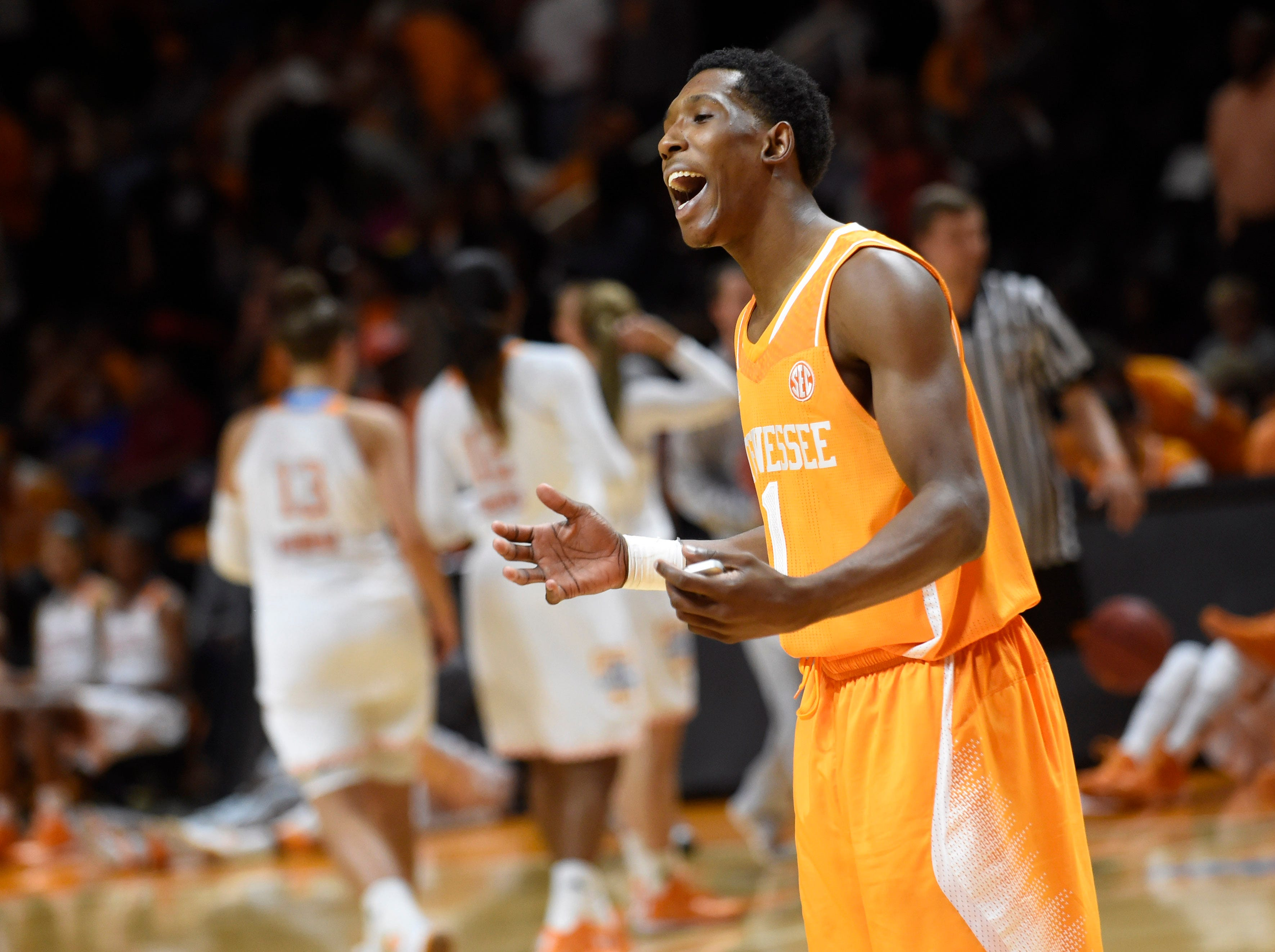 Tennessee basketball senior Josh Richardson (1) reacts to fans during Big Orange Madness at Thompson-Boling Arena on Friday, Oct. 24, 2014.