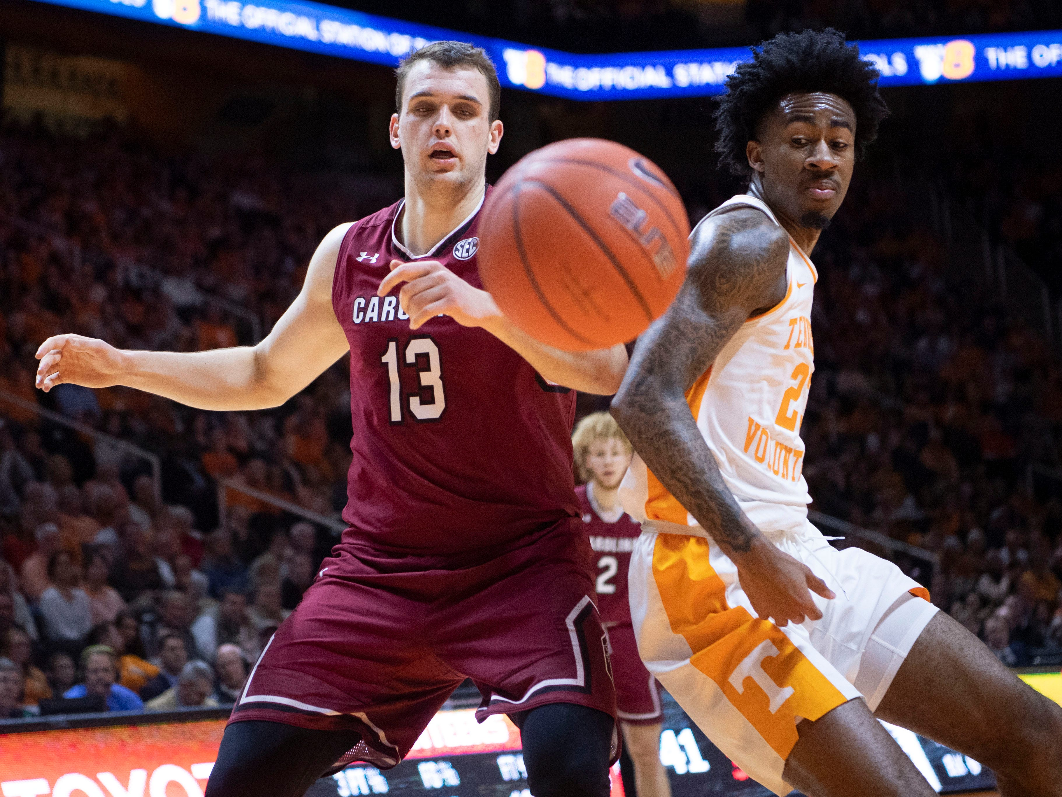 The ball goes out of bounds before South Carolina forward Felipe Haase (13) and Tennessee's Jordan Bowden (23) on Wednesday, February 13, 2019.