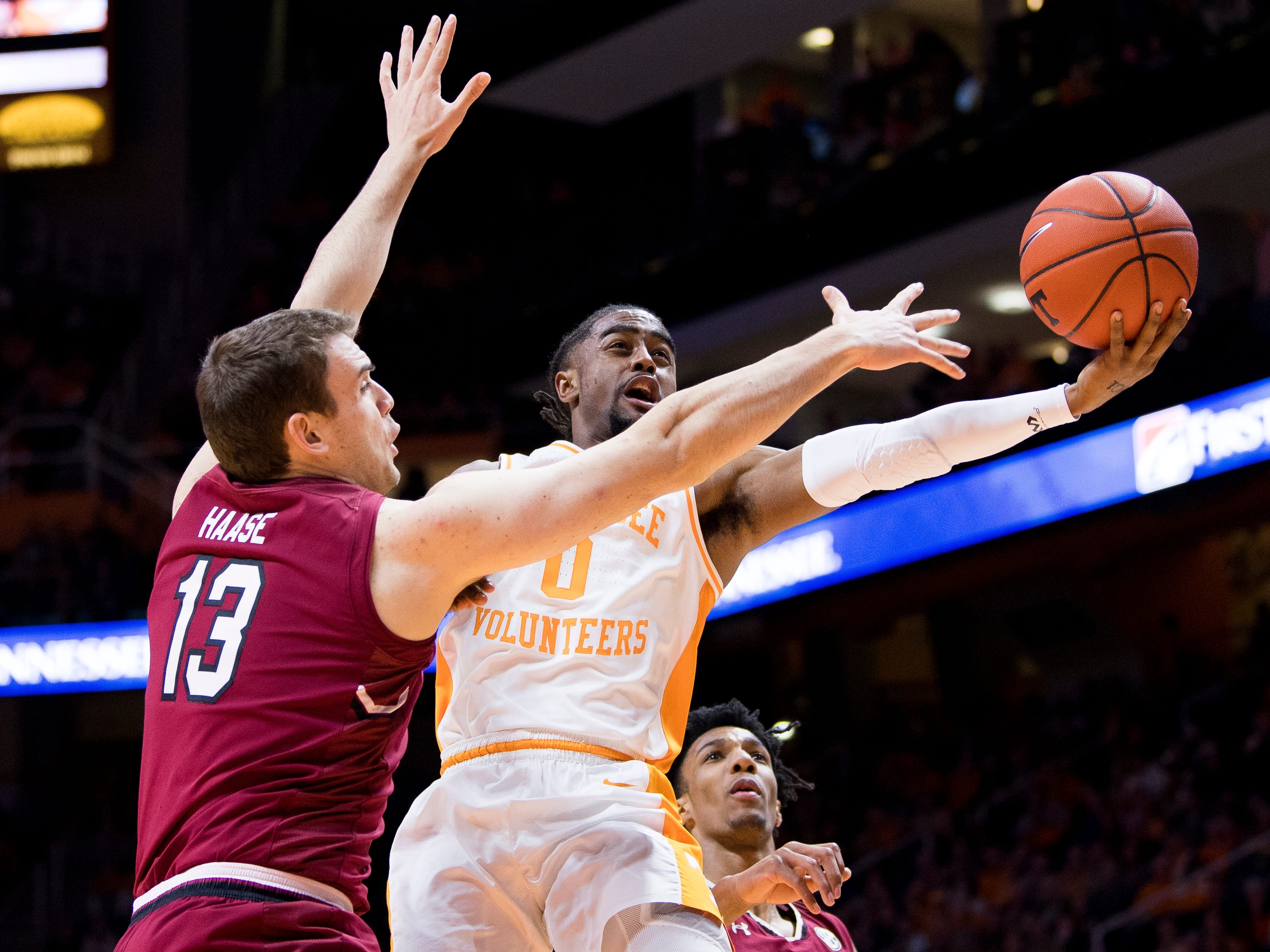 Tennessee guard Jordan Bone (0) attempts a shot past South Carolina forward Felipe Haase (13) during Tennessee's home SEC game against South Carolina at Thompson-Boling Arena in Knoxville on Wednesday, February 13, 2019.