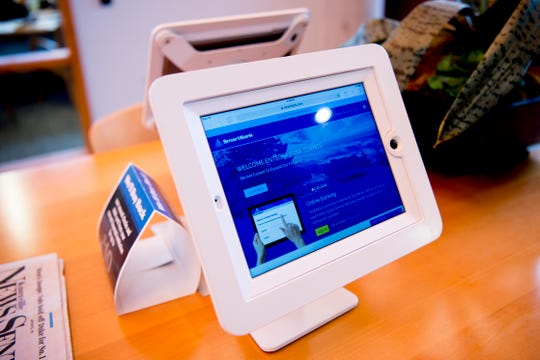 iPads are seen for customer use at the Cedar Bluff SmartBank location in West Knoxville, Tennessee on Tuesday, February 12, 2019. Pigeon Forge-founded SmartBank has signed a definitive merger agreement with North Carolina-based Entegra Bank.