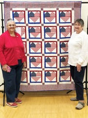 Halls Quilters Guild members Connie Johnsey, left, and Pat Muncey raffled off a quilt that Johnsey made.