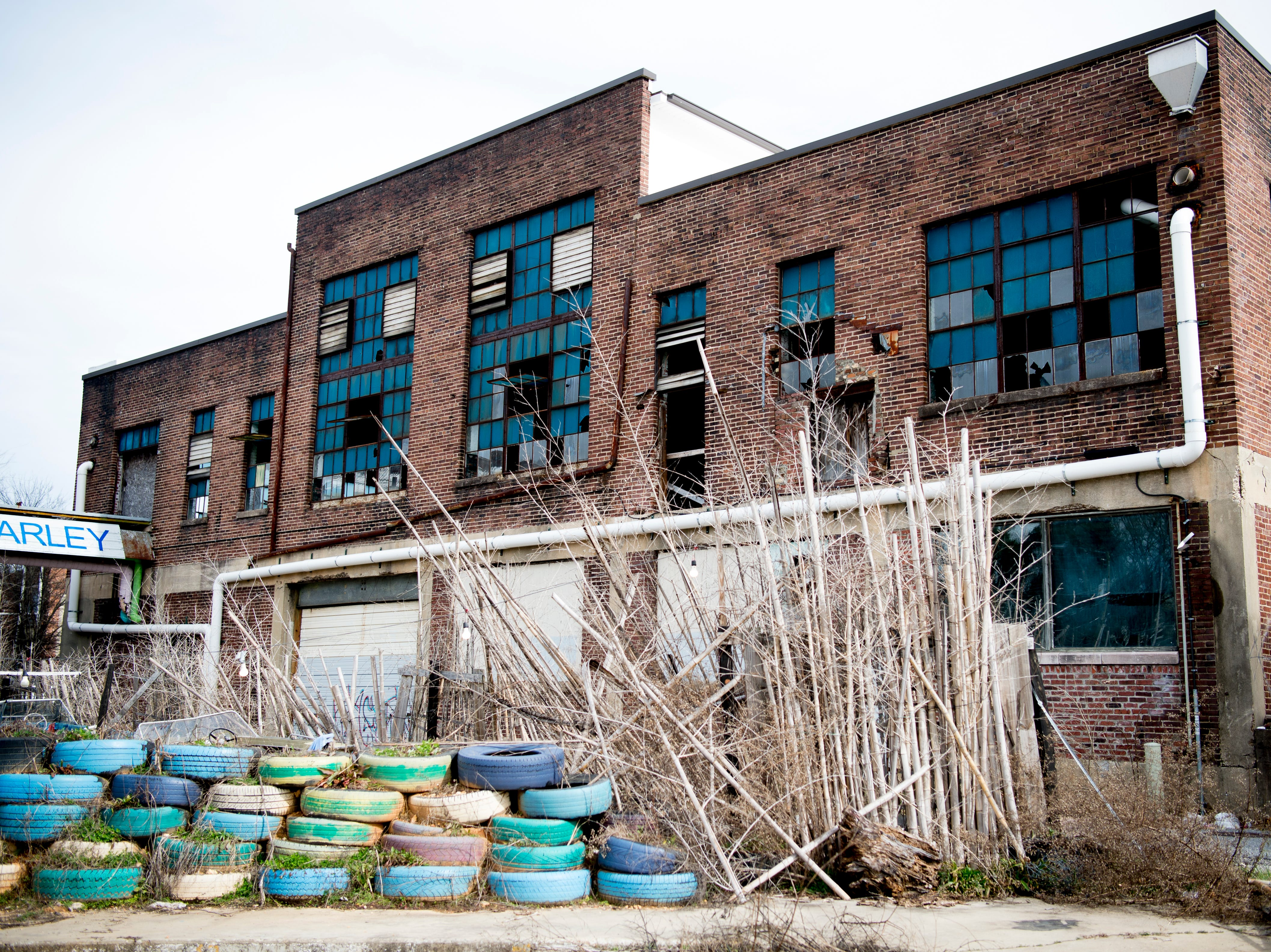 The neighboring building is planned for redevelopment beside Bar Marley in Knoxville, Tennessee on Thursday, February 14, 2019. The Caribbean-themed Bar Marley is facing possible acquisition and condemnation by KCDC due to code violations.
