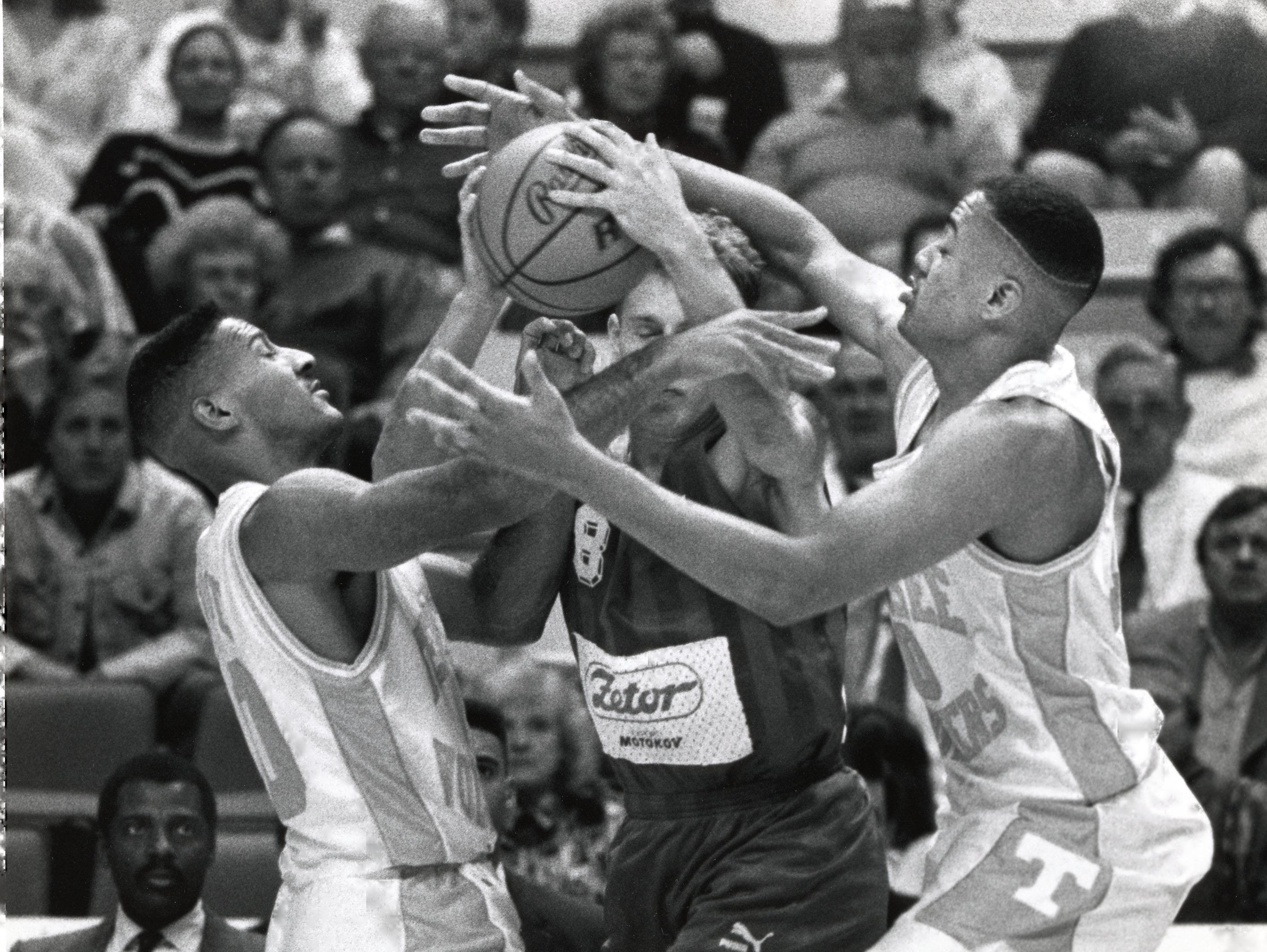 Tennessee's Jay Price (10) and Corey Allen (40) block in Czechslovakia's Martin Belik (8) during a game in November 1991.