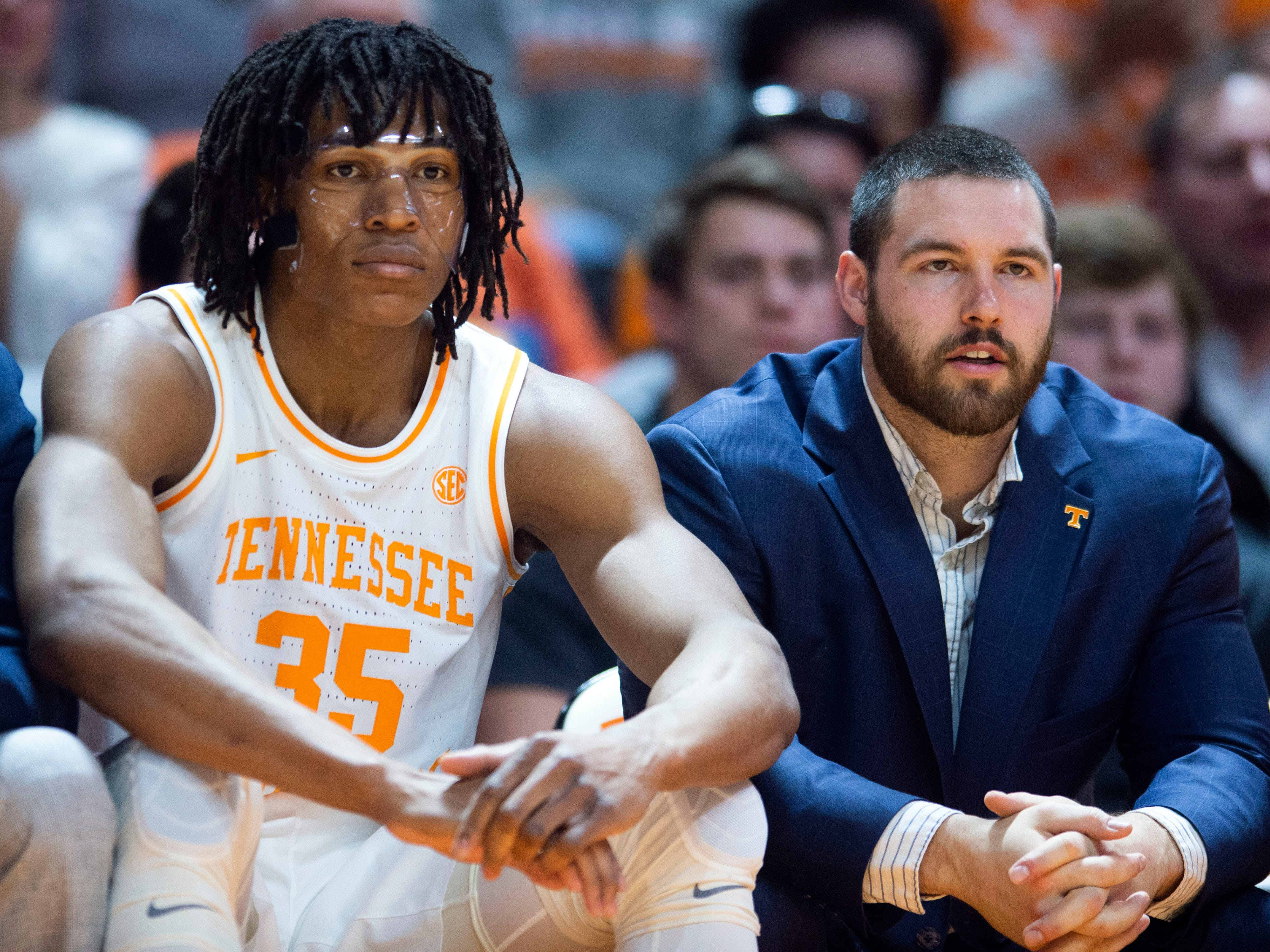 Tennessee's Yves Pons (35) sits with strength and conditioning coach Garrett Medenwald during the game against South Carolina on Wednesday, February 13, 2019.