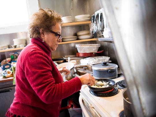 King Tut Grill owner Seham Girgis cooks a takeout order at her South Knoxville restaurant on Wednesday, February 13, 2019. Girgis said she may have to close the restaurant after KUB told her she needs a grease interceptor, which she says she cannot afford.