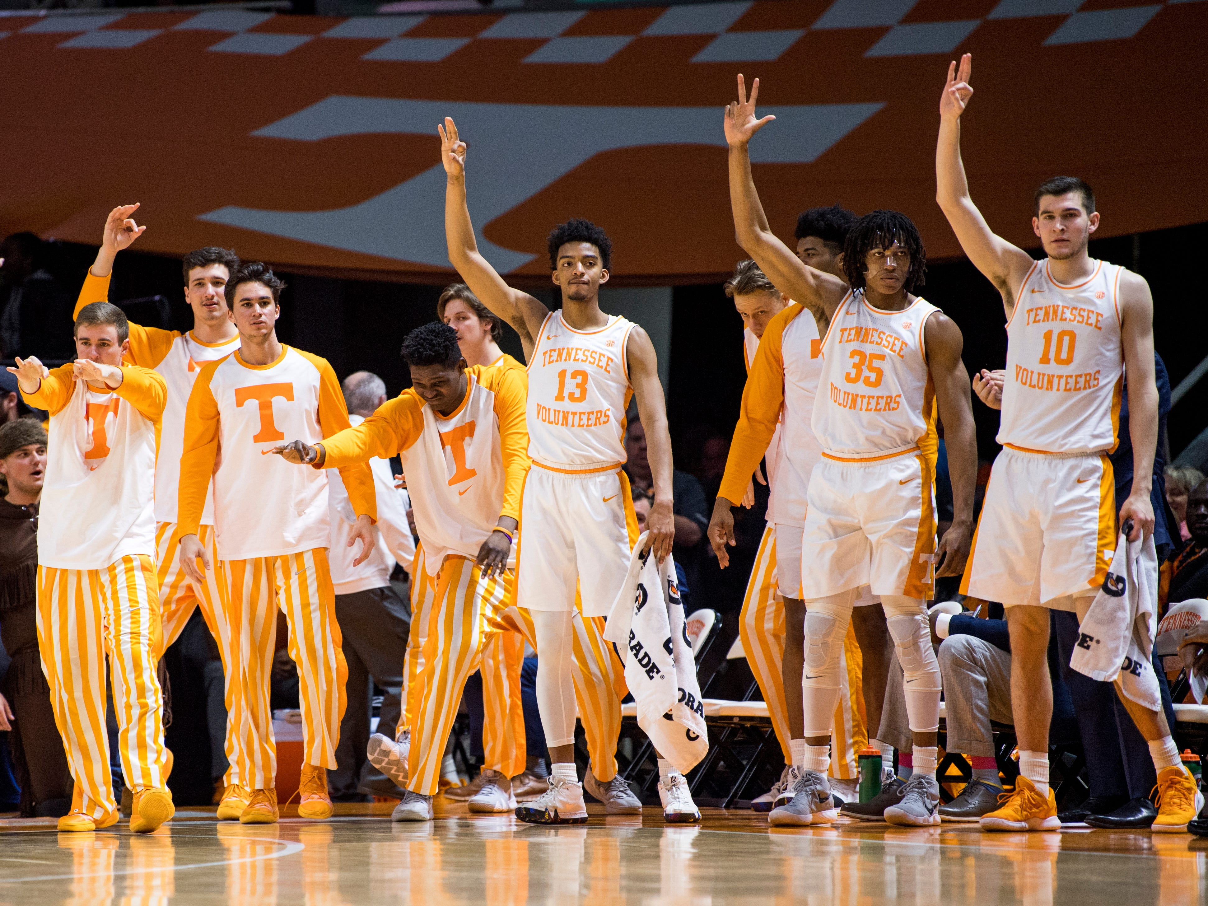 The Tennessee bench celebrates a three-pointer during Tennessee's home SEC game against South Carolina at Thompson-Boling Arena in Knoxville on Wednesday, February 13, 2019.