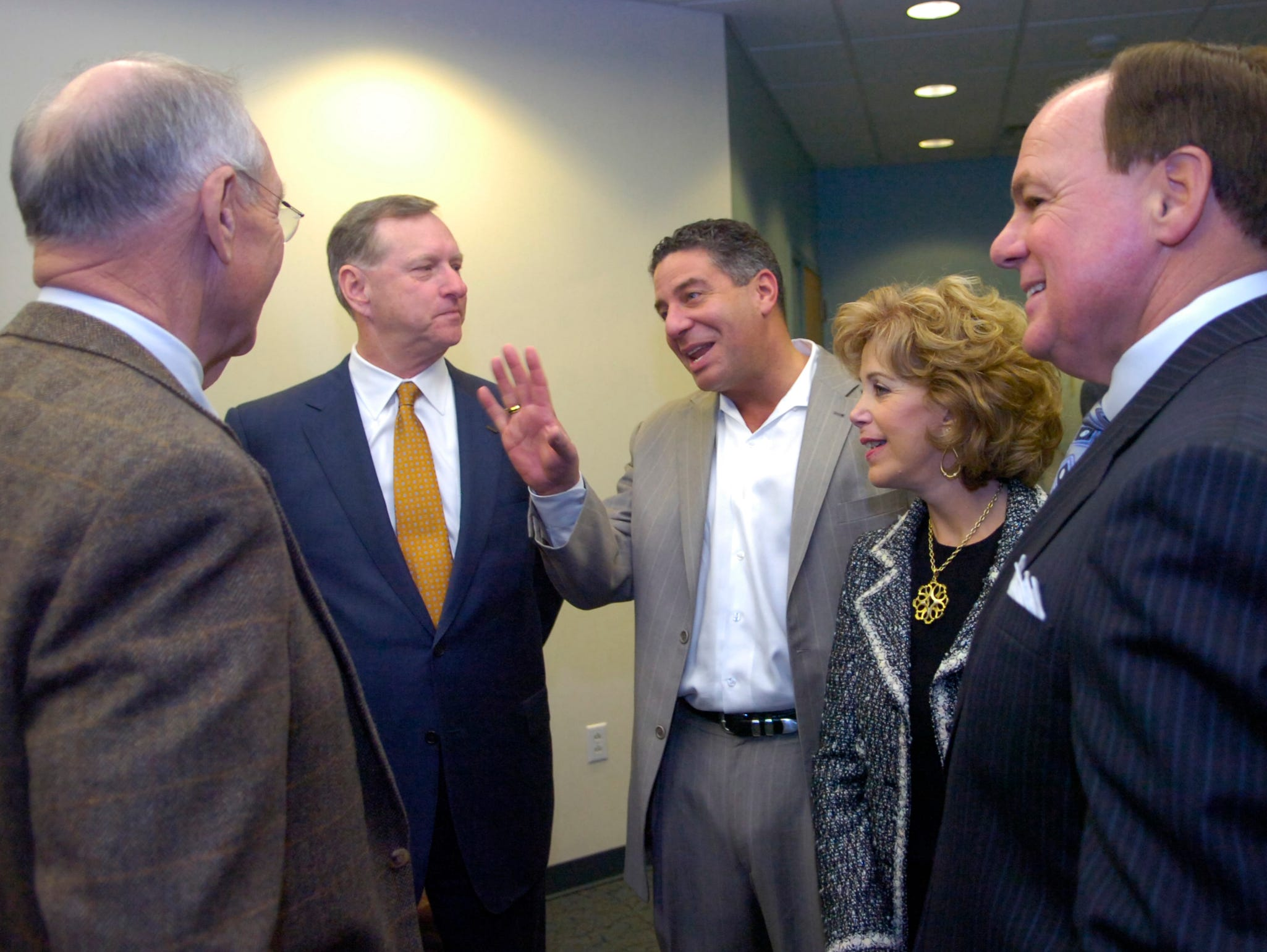 University of Tennessee men's basketball coach Bruce Pearl, center, chats with Jim Haslam of Pilot Corp., left, Scott Niswonger, founder of Landair Transport, Inc., and Forward Air Transport, Inc., and Wendy and Bob Goodfriend of Goody's Family Clothing, Inc., before a capital funds campaign announcement Tuesday at East Tennessee Children's Hospital. The hospital received pledges totaling $5 million. The funds will primarily go toward the hospital's recently completed $31.8 million construction/renovation project and increasing the hospital's endowment. 3/21/06