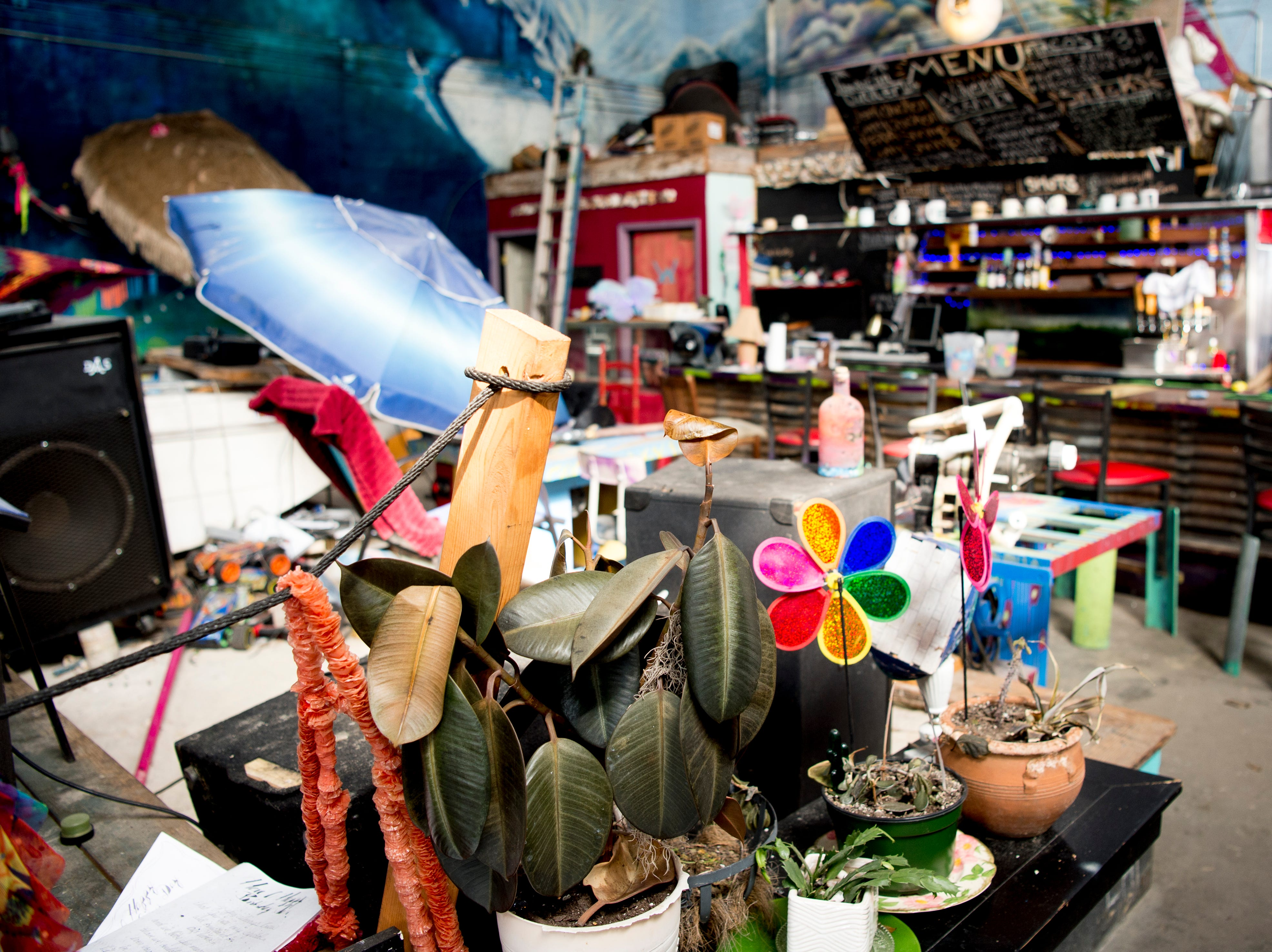 Various decorations sit beside the stage at Bar Marley in Knoxville, Tennessee on Thursday, February 14, 2019. The Caribbean-themed Bar Marley is facing possible acquisition and condemnation by KCDC due to code violations.