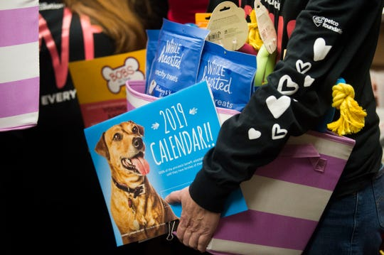 Gifts for the shelter are held at Young-Williams Animal Center in Knoxville Thursday, Feb. 14, 2019. The animal shelter received a surprise $750,000 grant from the Petco Foundation.Ê