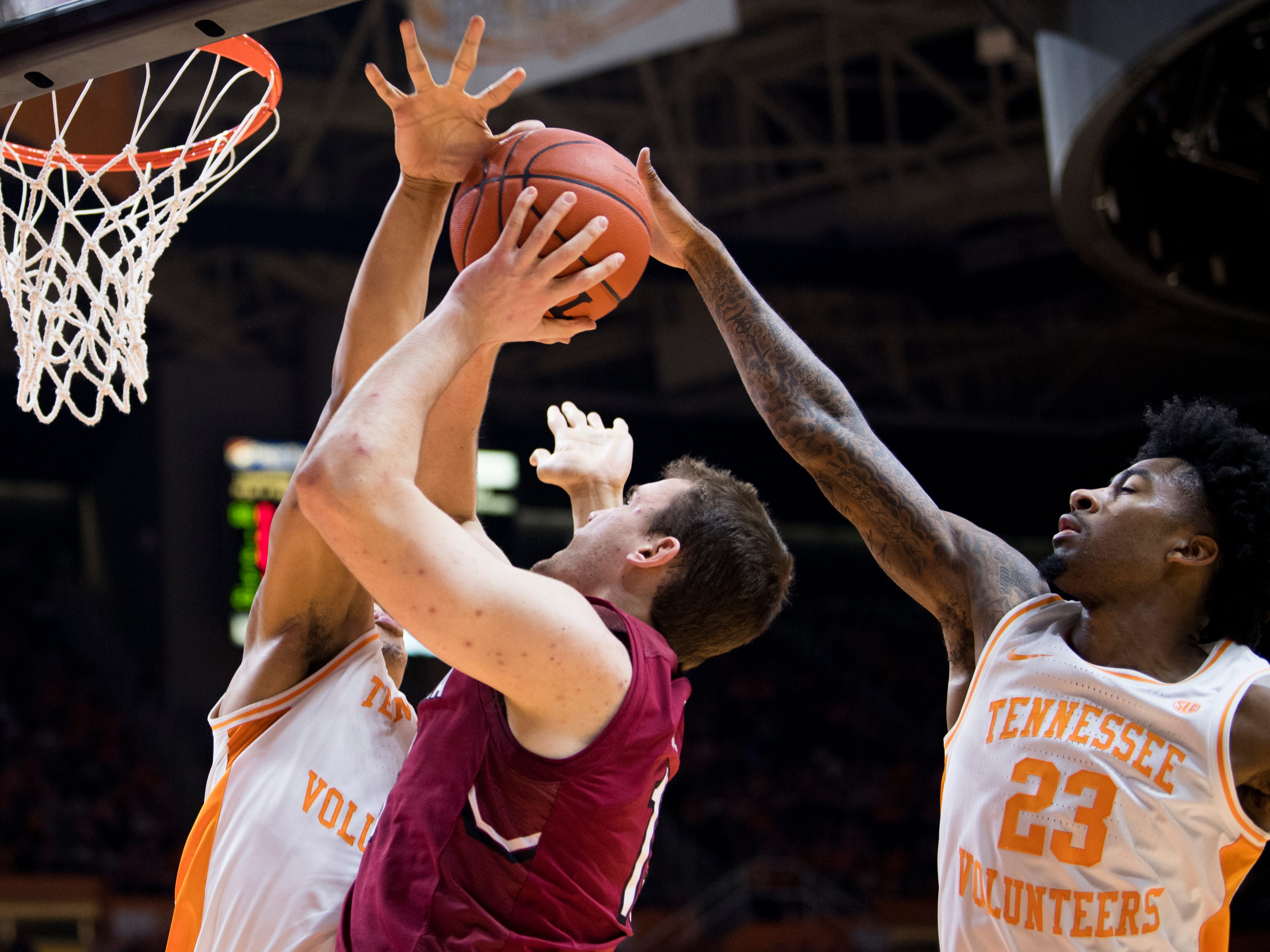 Tennessee forward Grant Williams (2) and Tennessee guard Jordan Bowden (23) defends South Carolina forward Felipe Haase (13) during Tennessee's home SEC game against South Carolina at Thompson-Boling Arena in Knoxville on Wednesday, February 13, 2019.