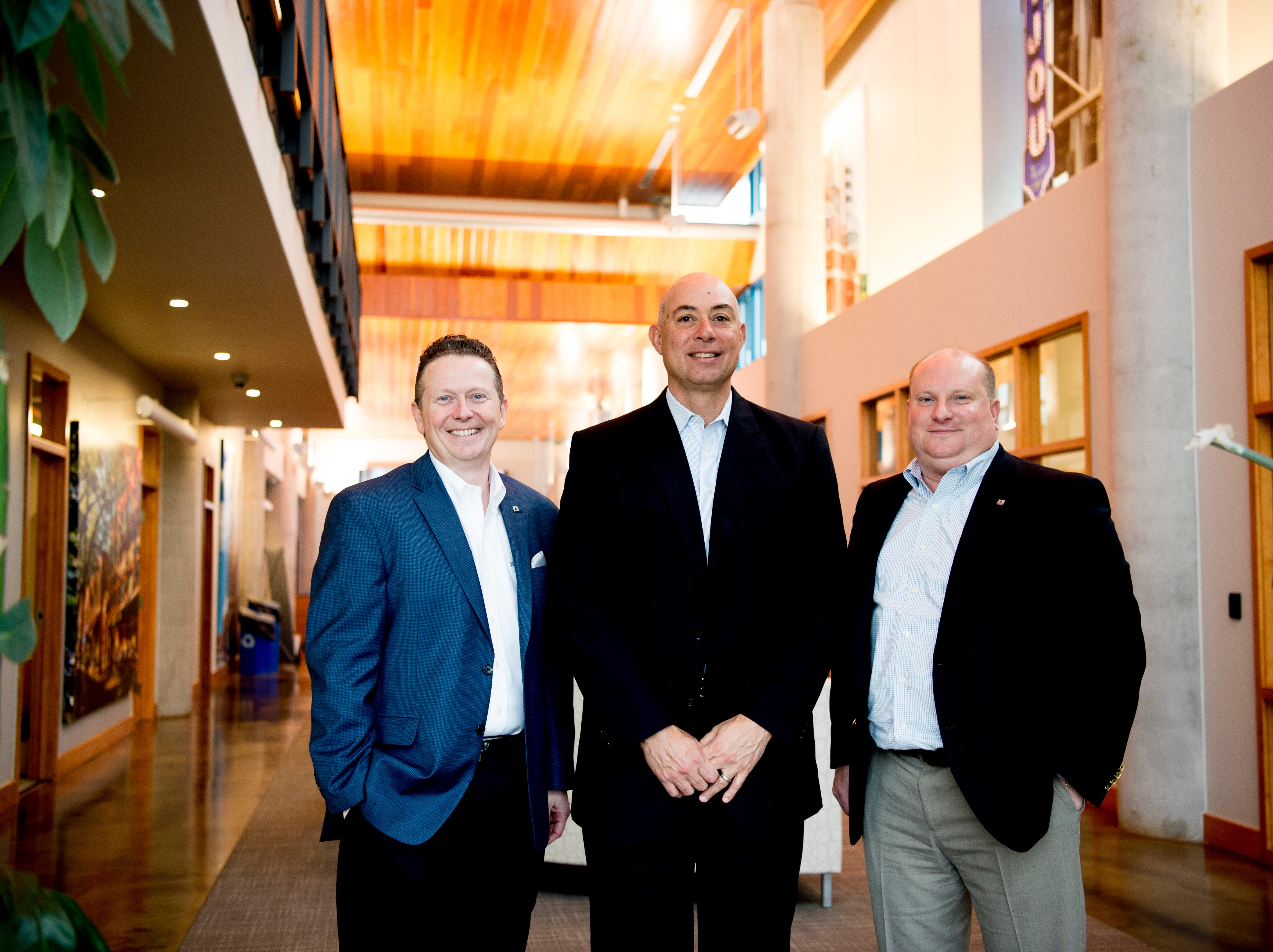 From left, Billy Carroll, President & Chief Executive Officer, Joe Hamdi, Market Executive, and Mike Honeycutt, Northeast Tennessee Regional President, pose for a photo at the Cedar Bluff SmartBank location in West Knoxville, Tennessee on Tuesday, February 12, 2019. Pigeon Forge-founded SmartBank has signed a definitive merger agreement with North Carolina-based Entegra Bank.