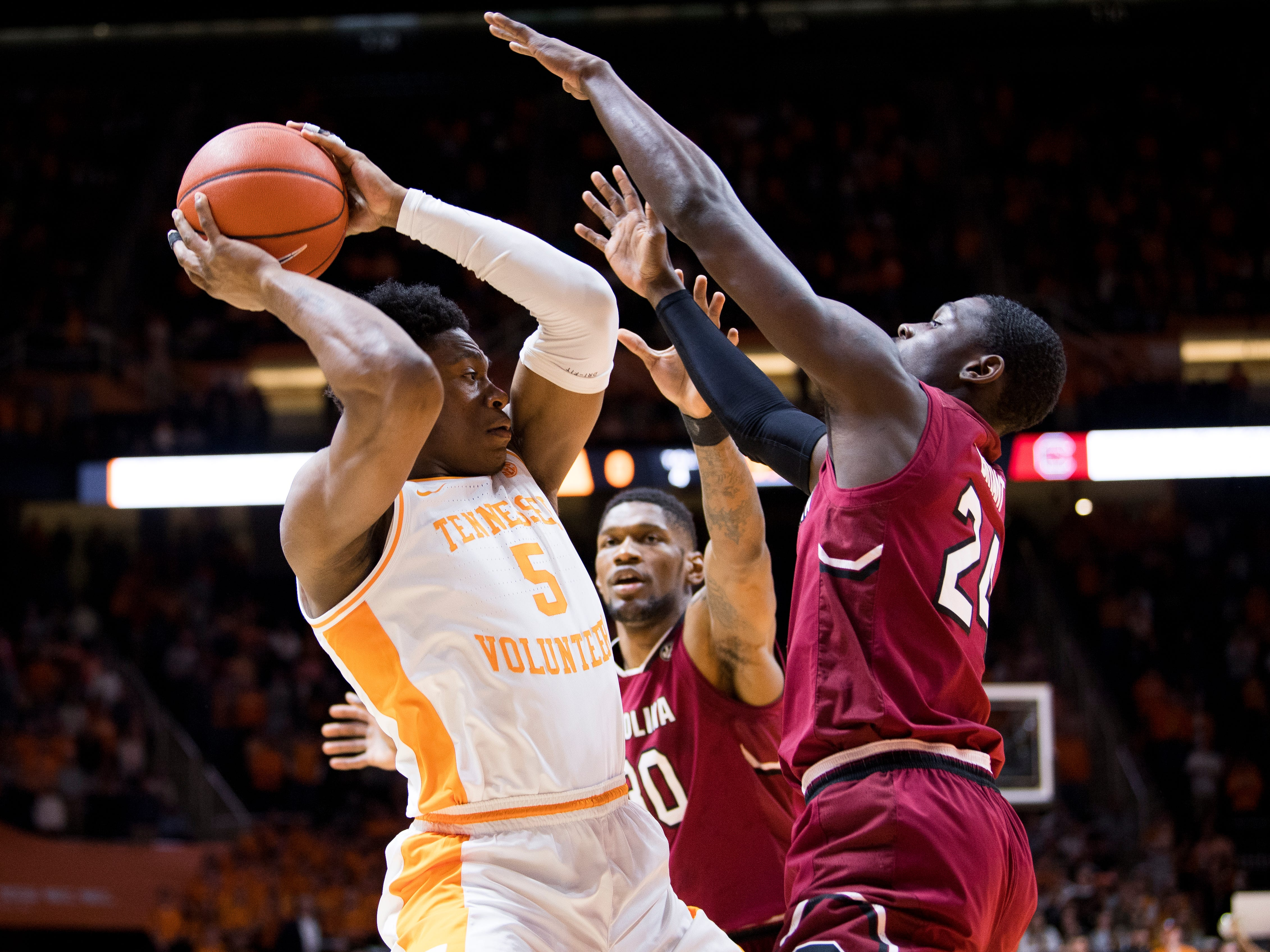 Tennessee guard Admiral Schofield (5) moves past South Carolina forward Keyshawn Bryant (24) and South Carolina forward Chris Silva (30) during Tennessee's home SEC game against South Carolina at Thompson-Boling Arena in Knoxville on Wednesday, February 13, 2019.