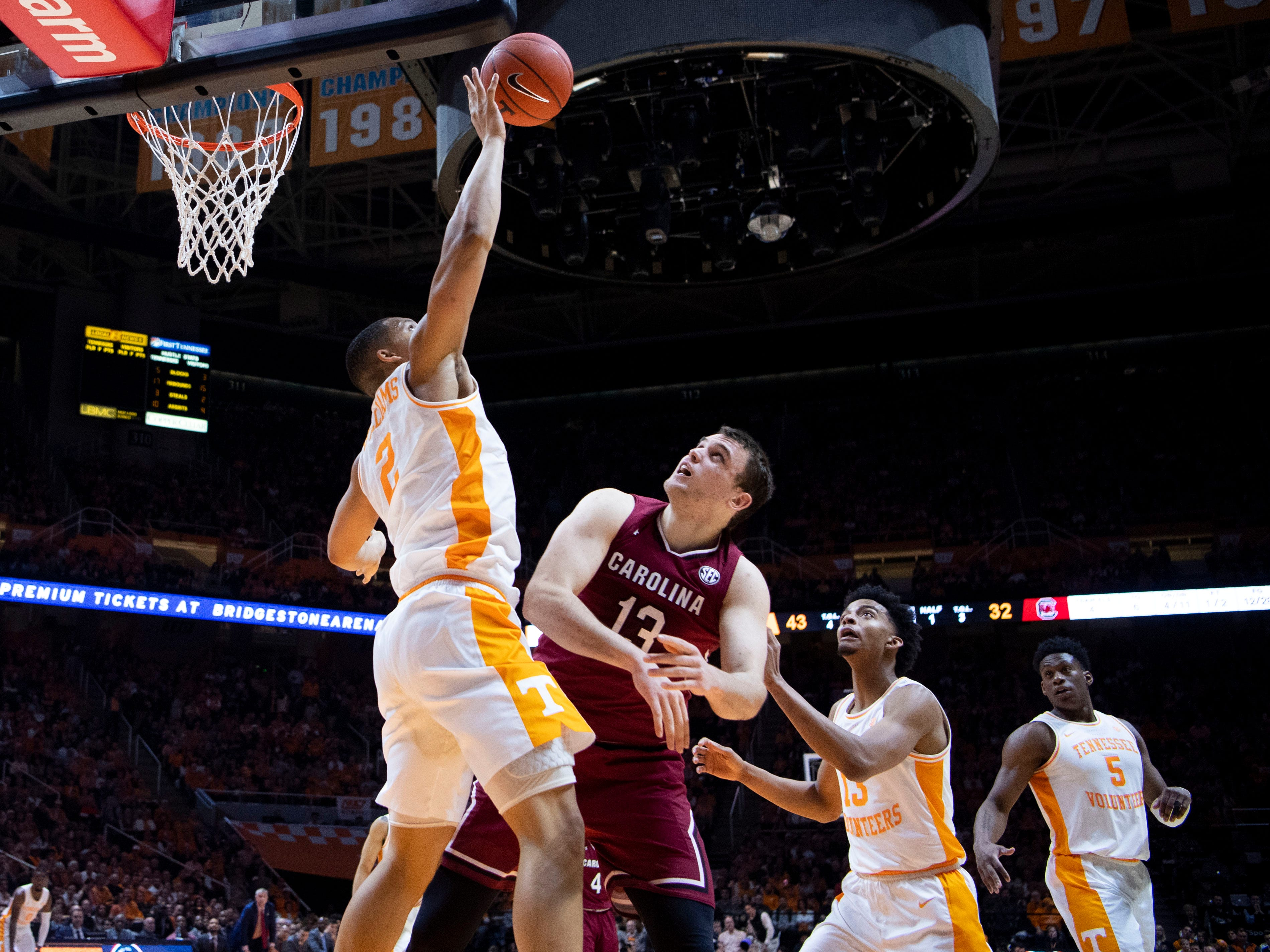 Tennessee's Grant Williams (2) blocks a shot attempt by South Carolina's Felipe Haase (13) on Wednesday, February 13, 2019.