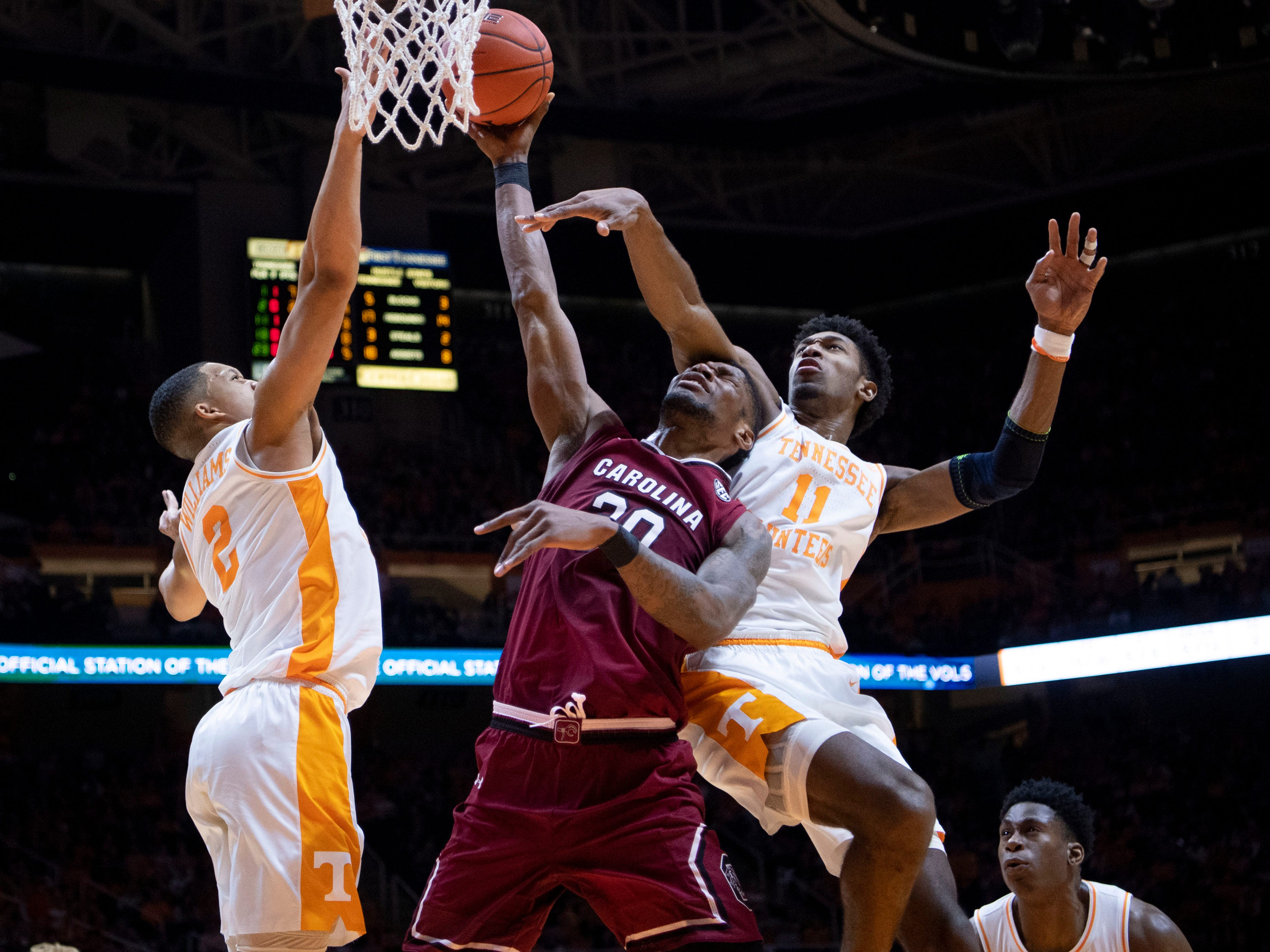 South Carolina forward Chris Silva (30) is guarded by Tennessee's Grant Williams (2) and Kyle Alexander (11) on Wednesday, February 13, 2019.