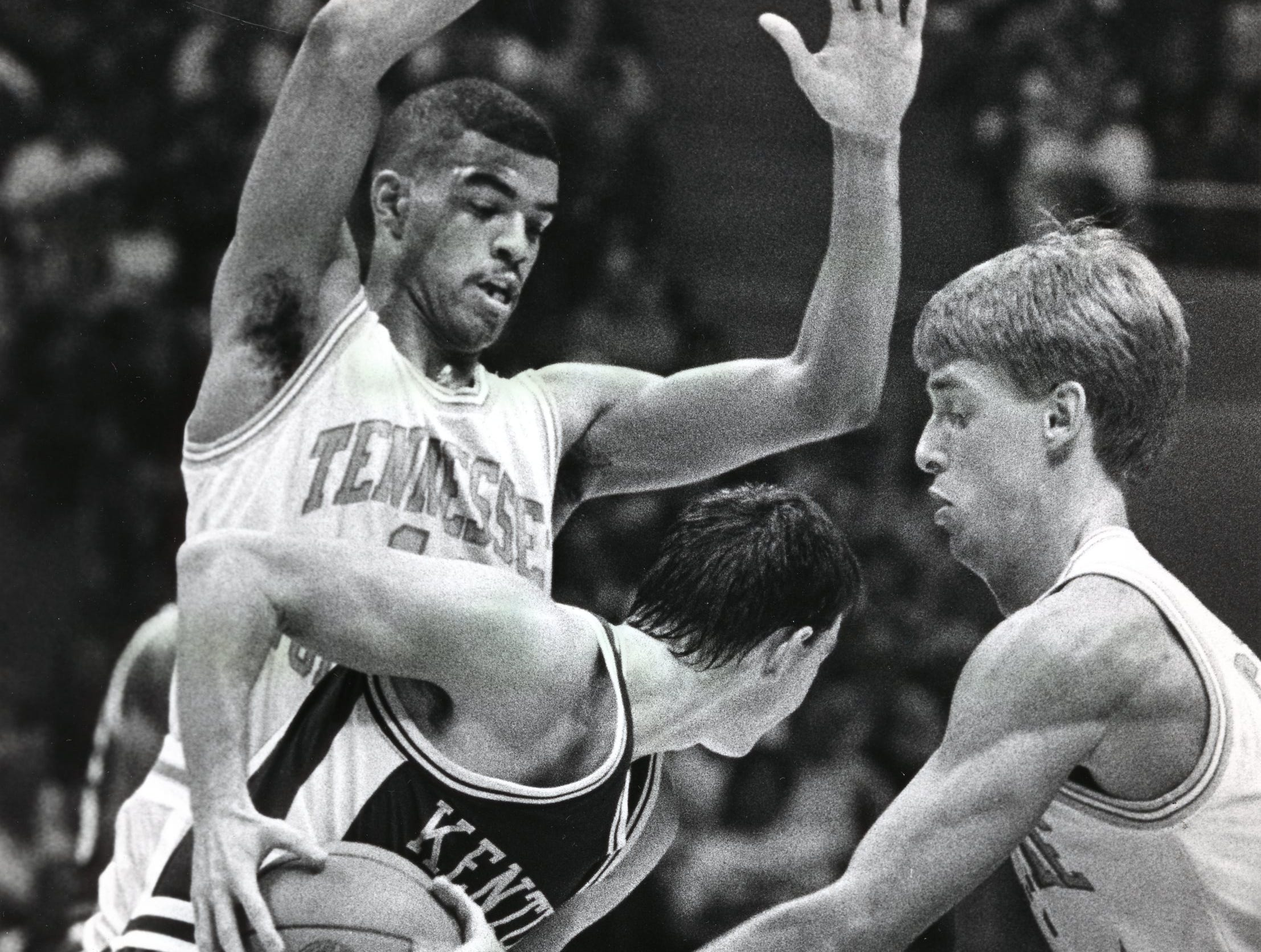 Tennessee's Clarence Swearengen and Mark Griffin defends Kentucky's Jean Sutton in a January 1989 game.