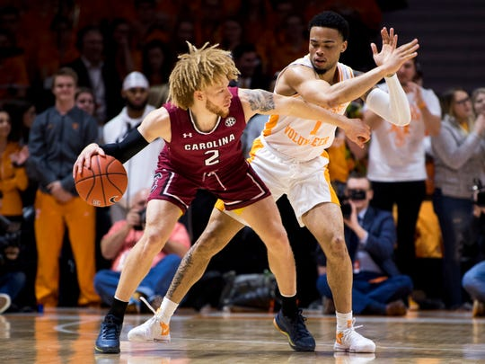 Tennessee guard Lamonte Turner (1) defends South Carolina guard Hassani Gravett (2) during Tennessee's home SEC game against South Carolina at Thompson-Boling Arena in Knoxville on Wednesday, February 13, 2019.