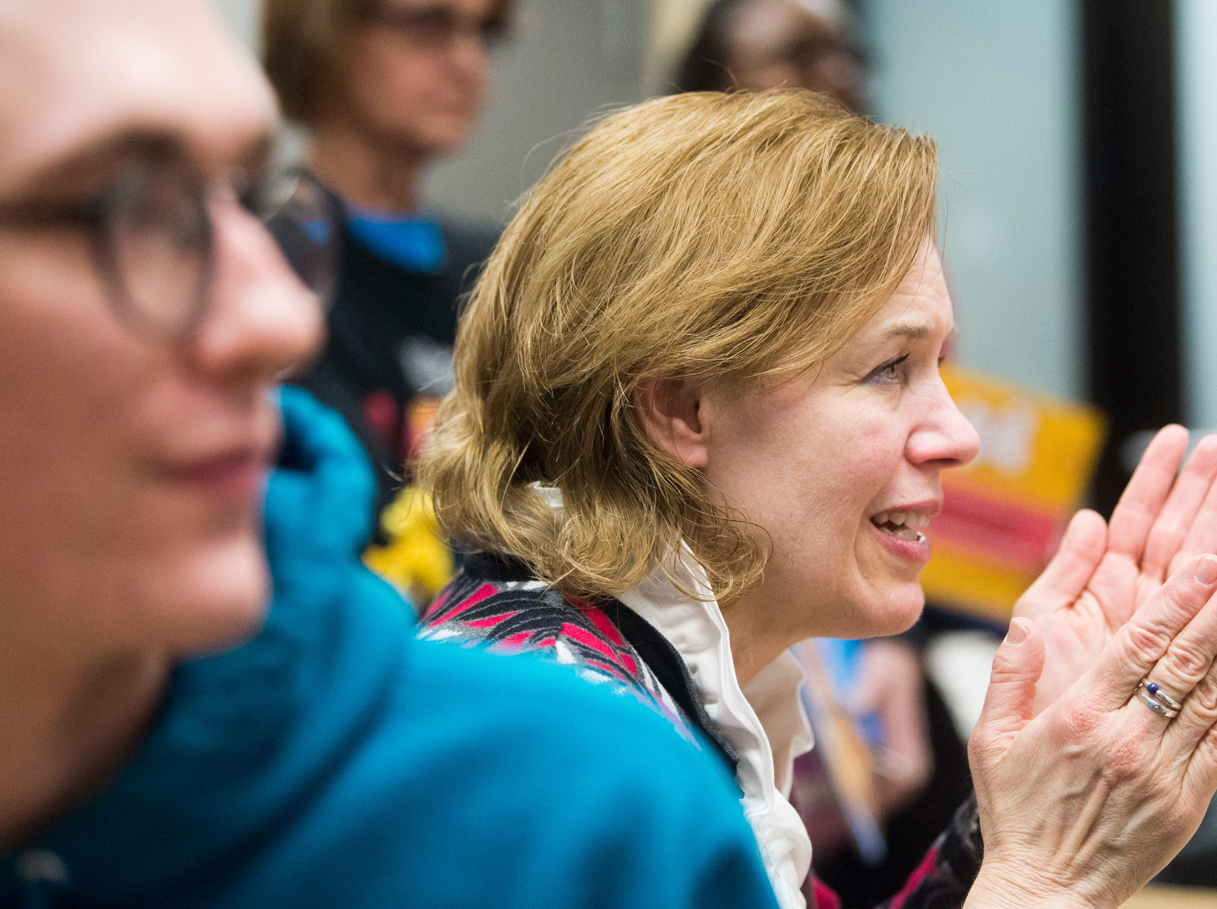 Jenny Richter, a member of Young-Williams Animal Center's board, reacts to hearing the Petco Foundation donated a surprise $750,000 grant to the shelter, Thursday, Feb. 14, 2019.