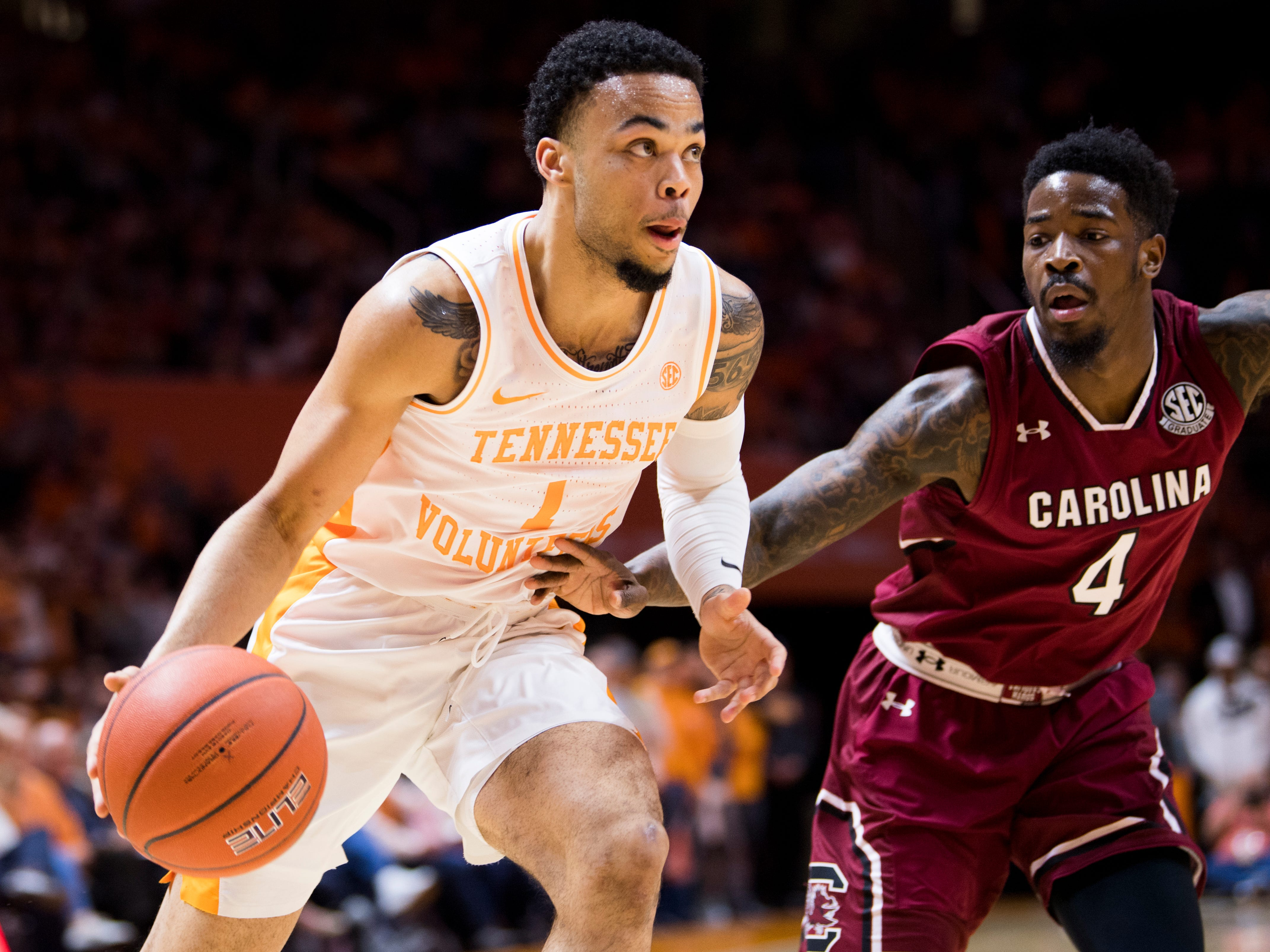 Tennessee guard Lamonte Turner (1) drives past South Carolina guard Tre Campbell (4) during Tennessee's home SEC game against South Carolina at Thompson-Boling Arena in Knoxville on Wednesday, February 13, 2019.