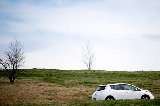 One of the Nissan Leaf electric vehicles owned by the University of Tennessee drives through the Cherokee Farm campus in Knoxville, Tennessee on Thursday, February 14, 2019. UT has a fleet of 11 Nissan Leaf electric vehicles and is expecting to grow the fleet's size over the coming years.