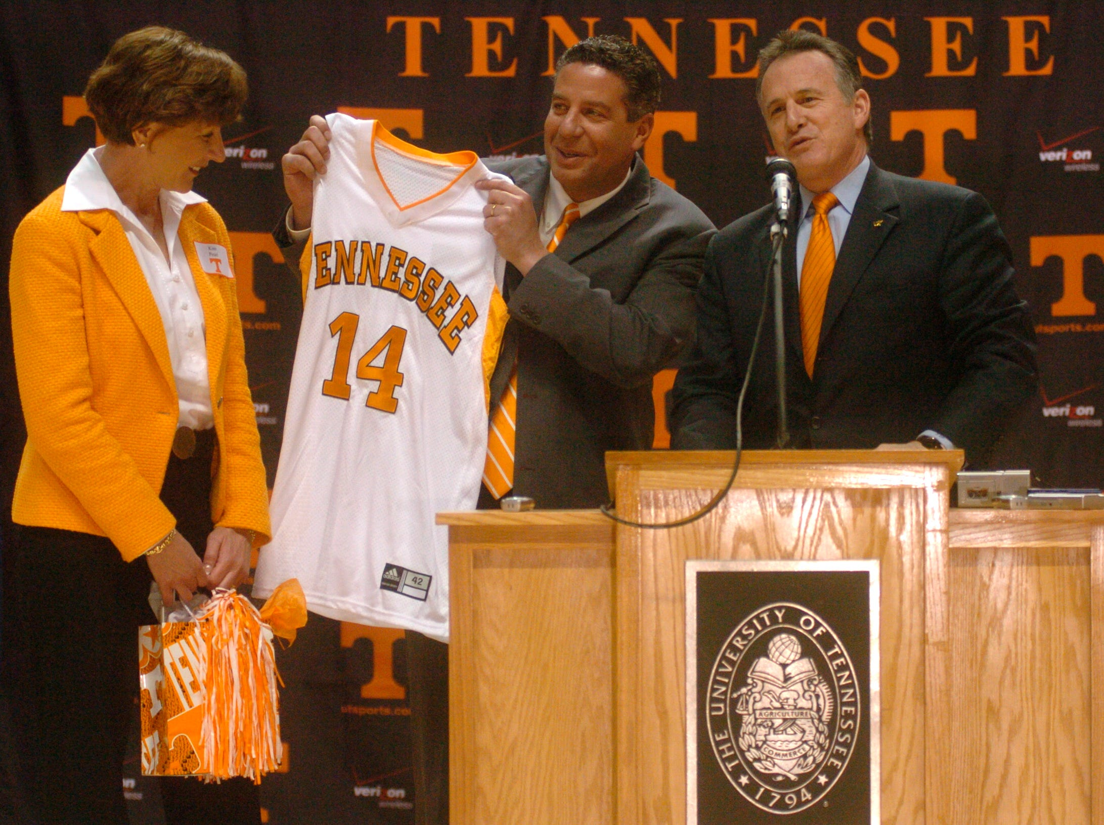 New Tennessee men's basketball coach Bruce Pearl and his wife Kim accept a Tennessee Jersey from UT President John Petersen while he is introduced during a press conference to name him as the new coach at Thompson-Boling Arena Monday afternoon. Pearl takes over at UT after coaching at Winsonsin-Milwaukee.