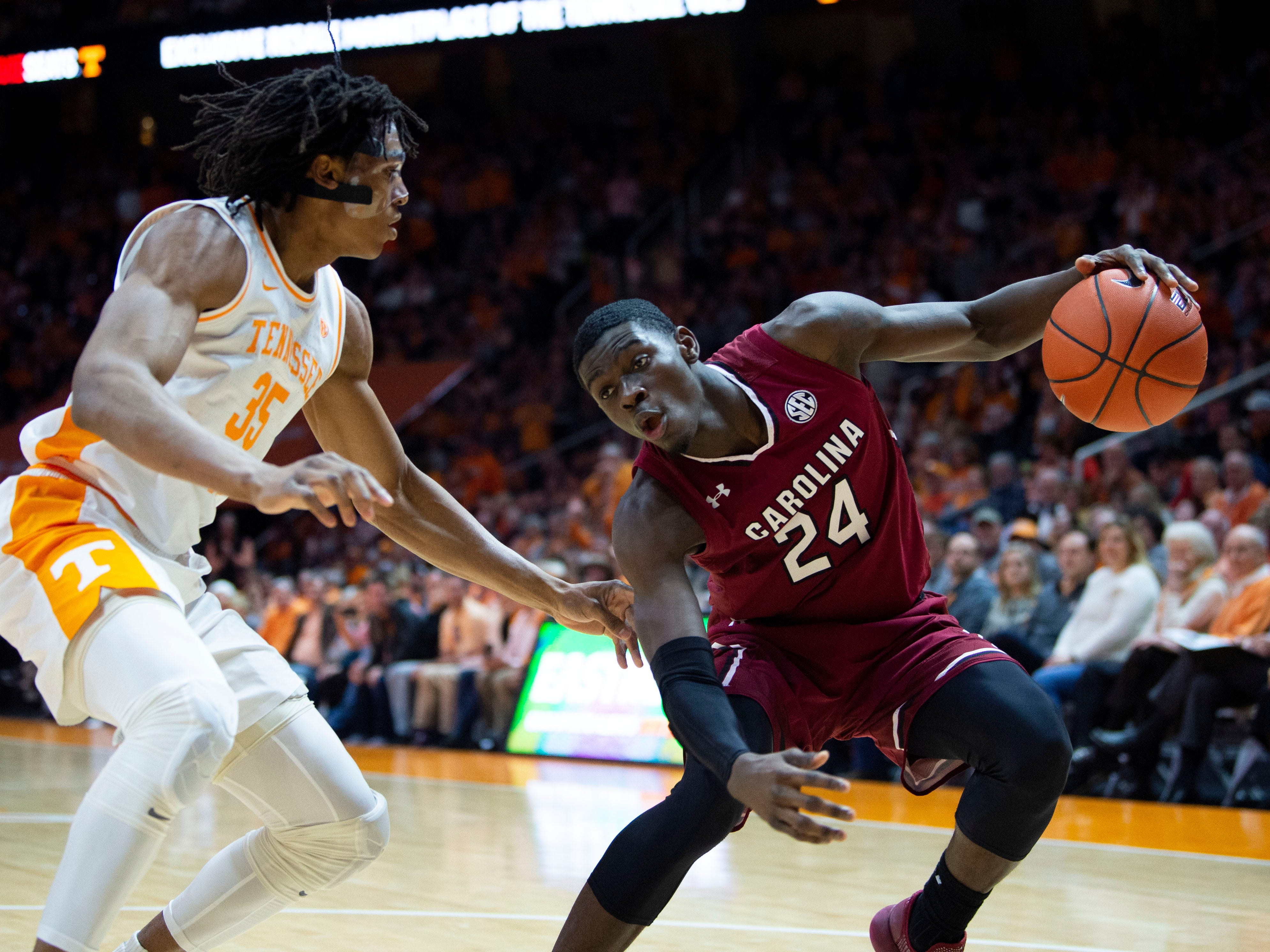 South Carolina forward Keyshawn Bryant (24) is guarded be Tennessee's Yves Pons (35) on Wednesday, February 13, 2019.