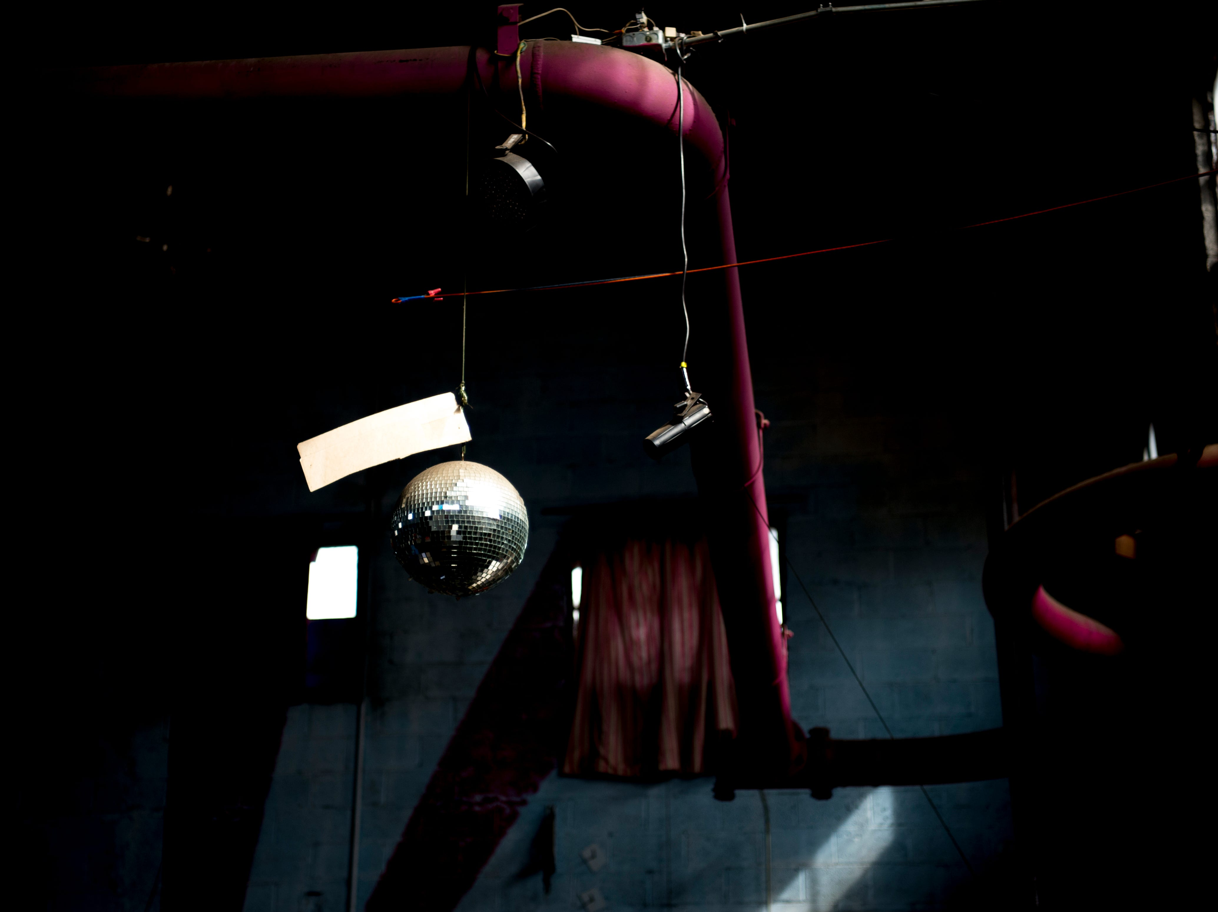 A disco ball hangs from the ceiling at Bar Marley in Knoxville, Tennessee on Thursday, February 14, 2019. The Caribbean-themed Bar Marley is facing possible acquisition and condemnation by KCDC due to code violations.