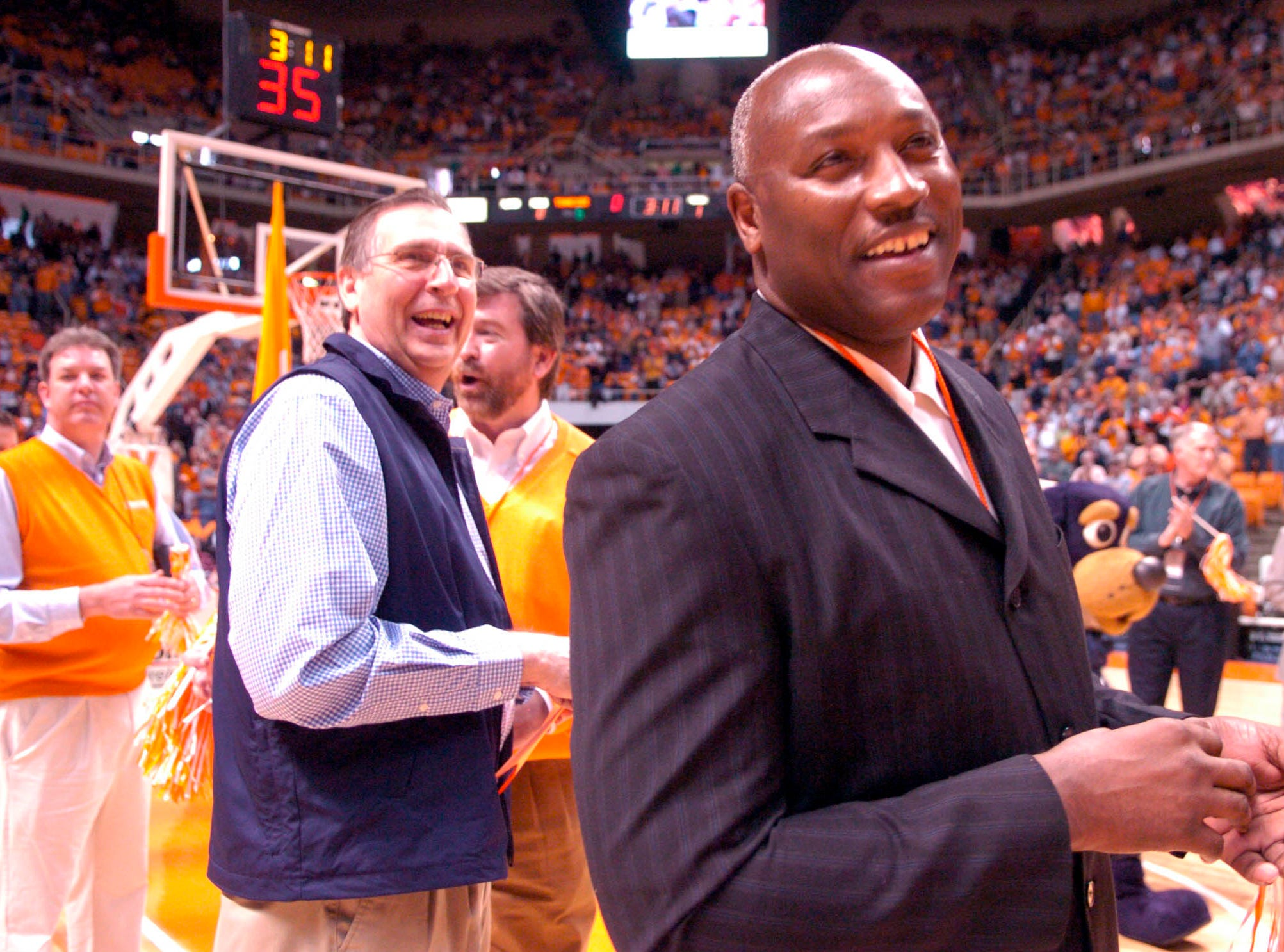Former Tennessee basketball player Larry Robinson (right) stands next to former head coach Don DeVoe as players from the 1970's welcomed the current team onto the court.2006