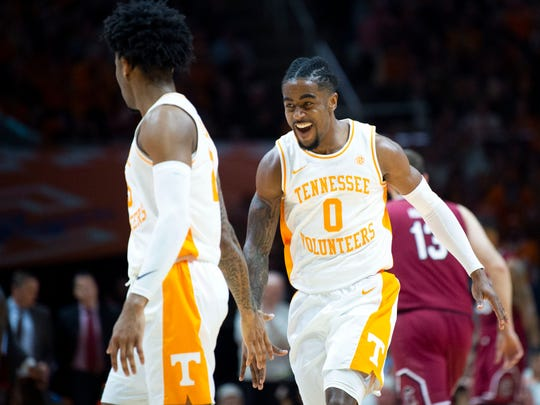 Tennessee's Jordan Bone (0) congratulates Jordan Bowden (23) after Bowden scored 3 against South Carolina on Wednesday, February 13, 2019.