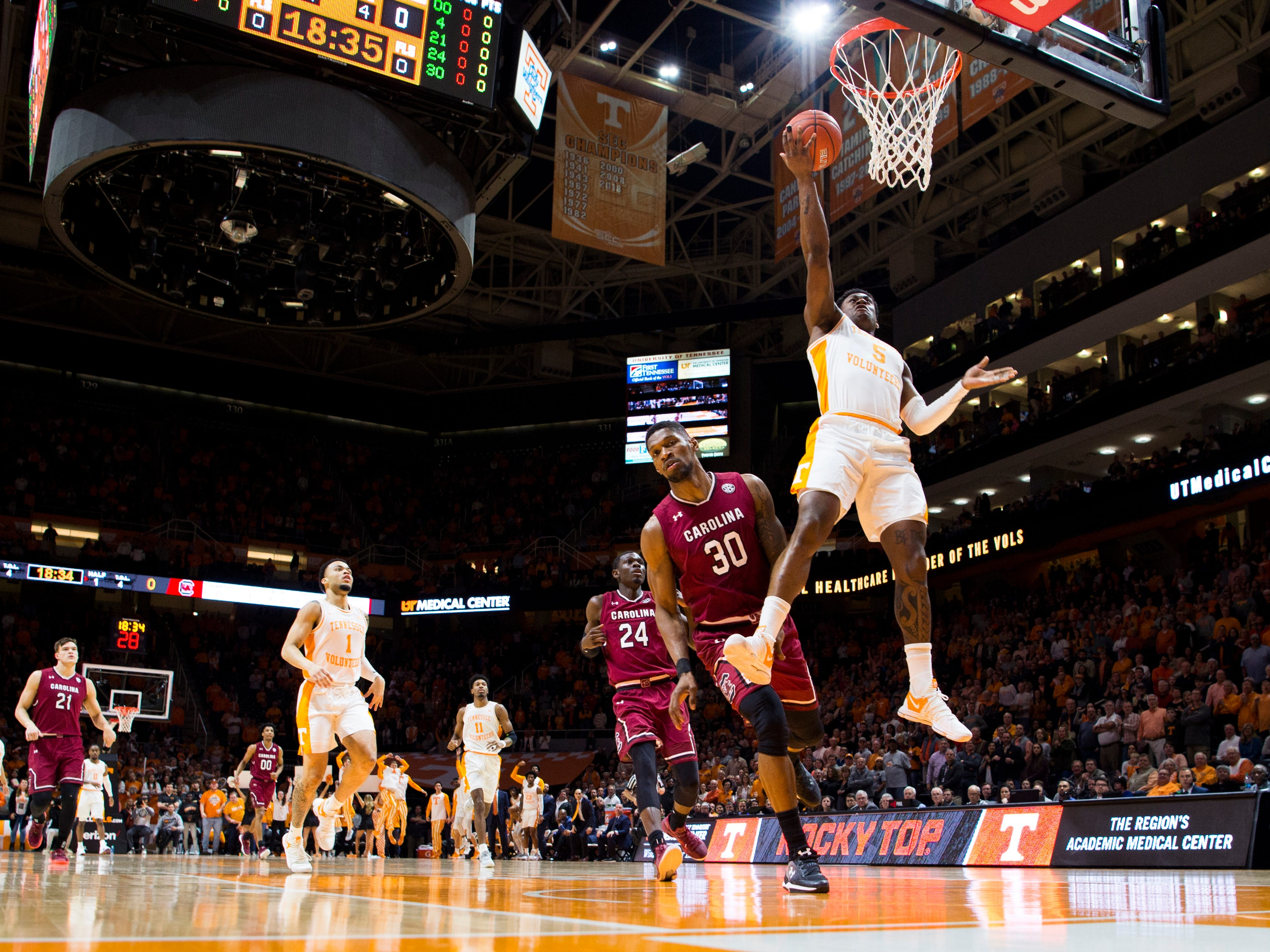 Tennessee guard Admiral Schofield (5) dunks the ball during Tennessee's home SEC game against South Carolina at Thompson-Boling Arena in Knoxville on Wednesday, February 13, 2019.