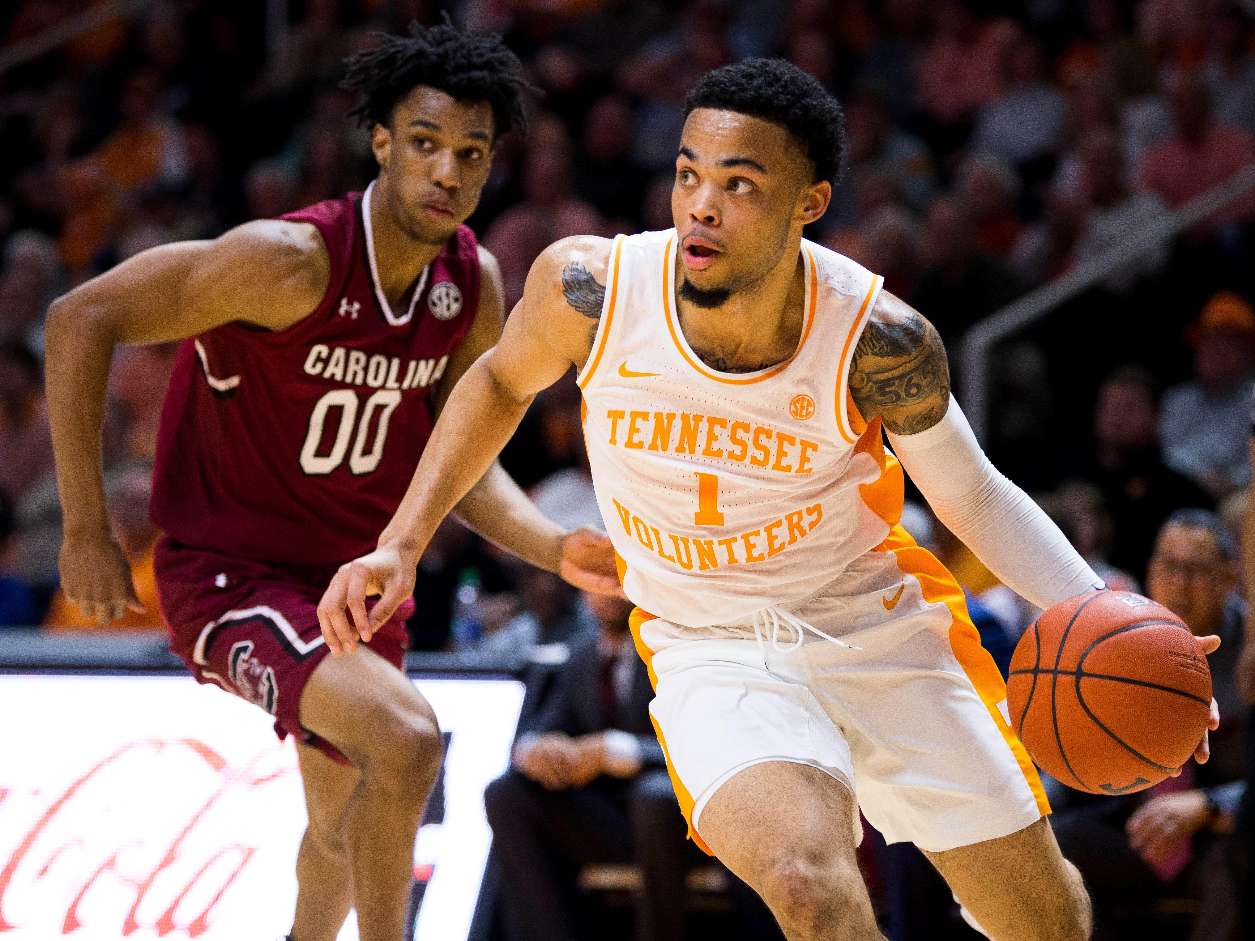Tennessee guard Lamonte Turner (1) drives past South Carolina guard A.J. Lawson (0) during Tennessee's home SEC game against South Carolina at Thompson-Boling Arena in Knoxville on Wednesday, February 13, 2019.