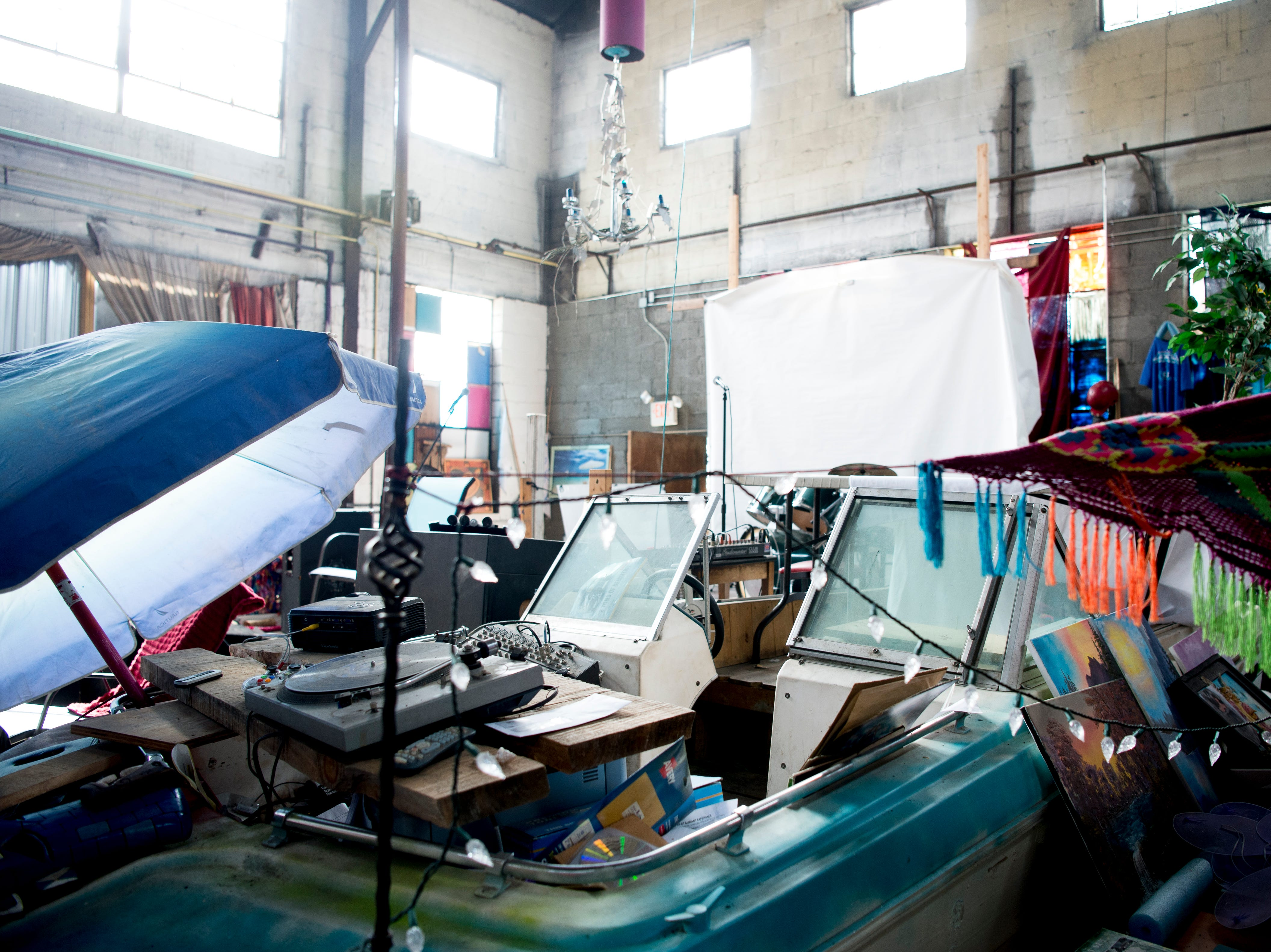 A boat sits in the center of the venue at Bar Marley in Knoxville, Tennessee on Thursday, February 14, 2019. The Caribbean-themed Bar Marley is facing possible acquisition and condemnation by KCDC due to code violations.