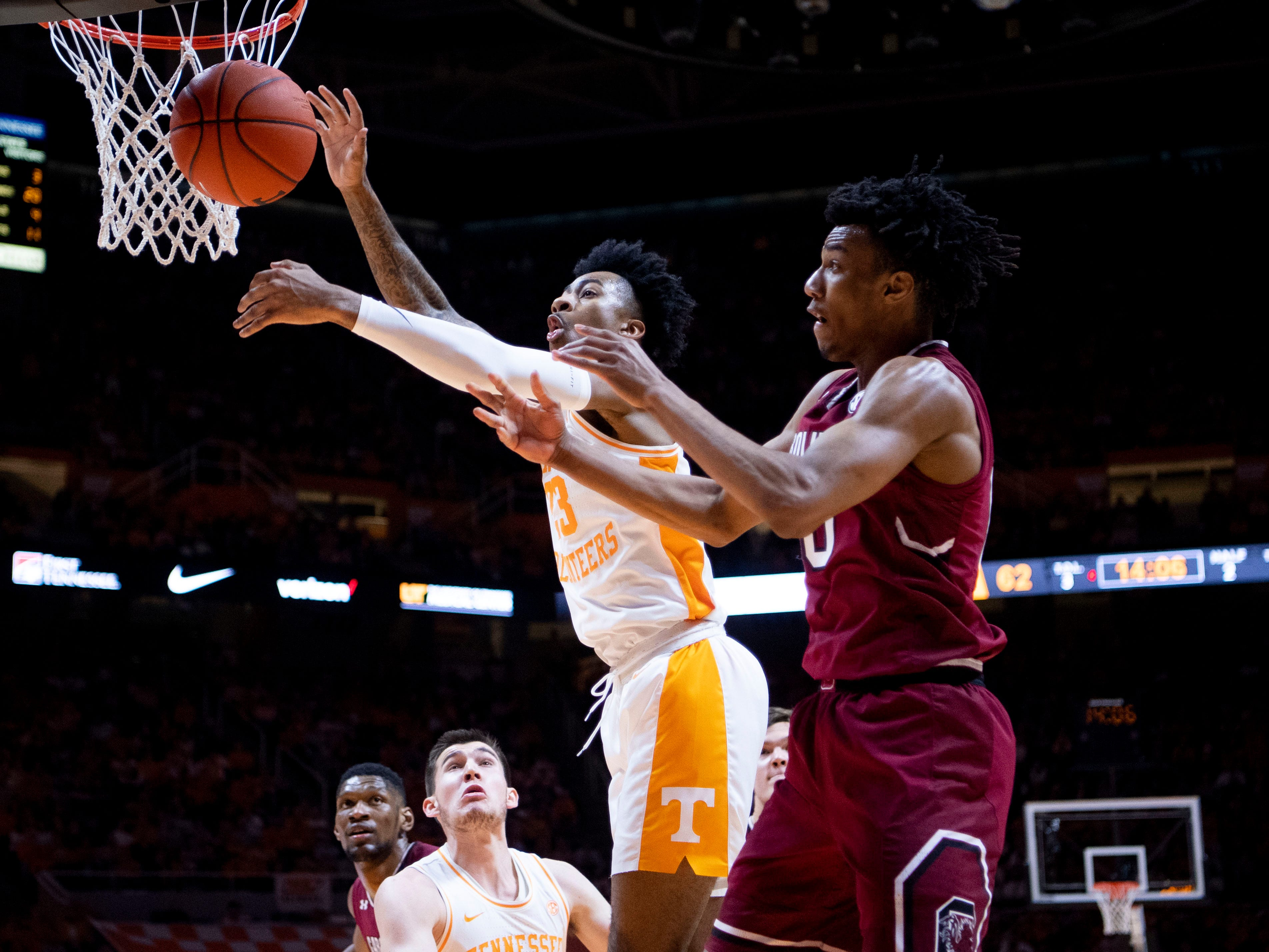 Tennessee's Jordan Bowden (23) gets the rebound over South Carolina guard A.J. Lawson (0) on Wednesday, February 13, 2019.