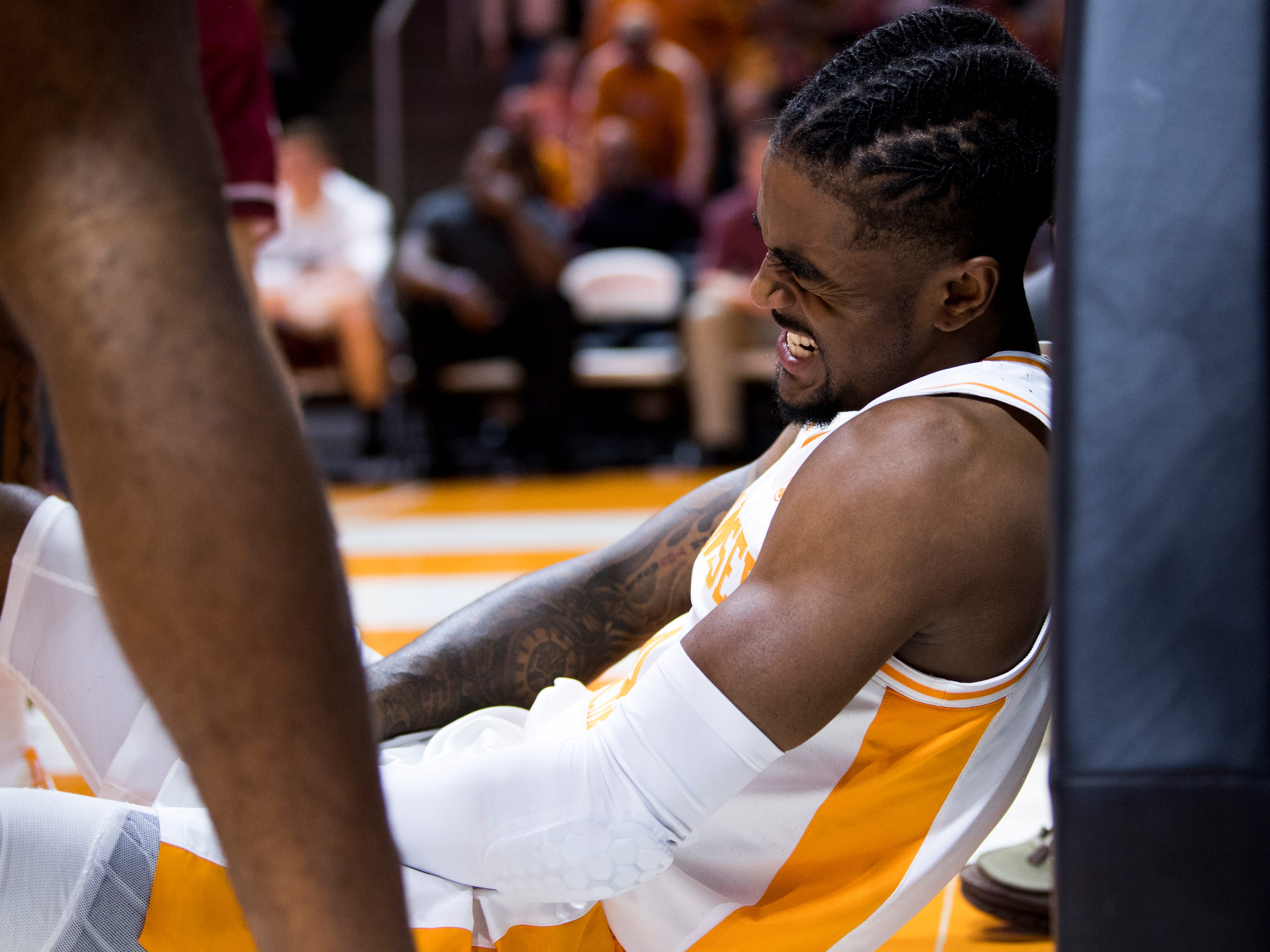 Tennessee guard Jordan Bone (0) grimaces in pain after being fouled at the basket during Tennessee's home SEC game against South Carolina at Thompson-Boling Arena in Knoxville on Wednesday, February 13, 2019.