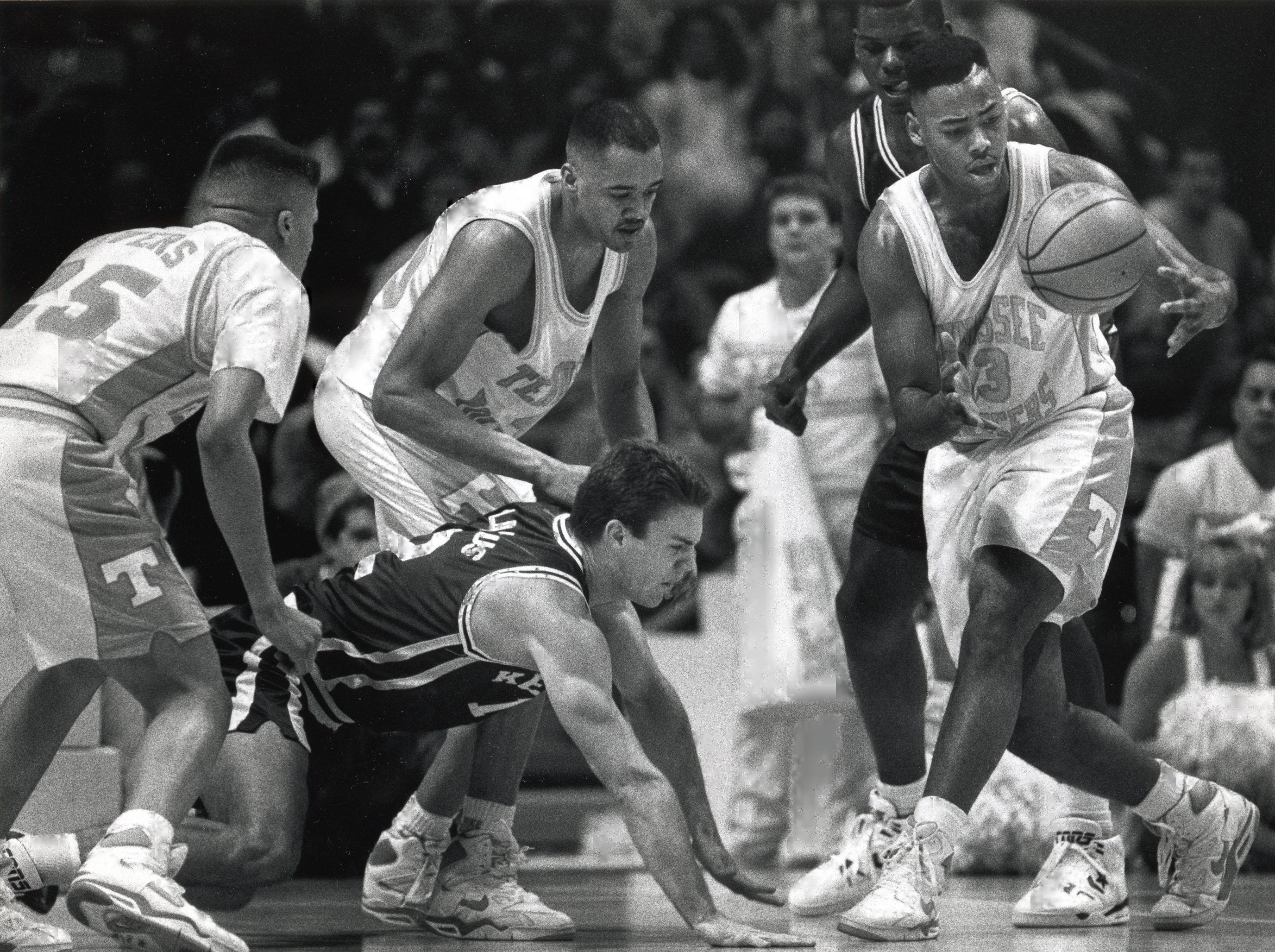 Tennessee's Carlus Groves (33) comes up with the loose ball as Kentucky's Deron Feldhaus (12) scrambles on the floor during a game in January 1992.