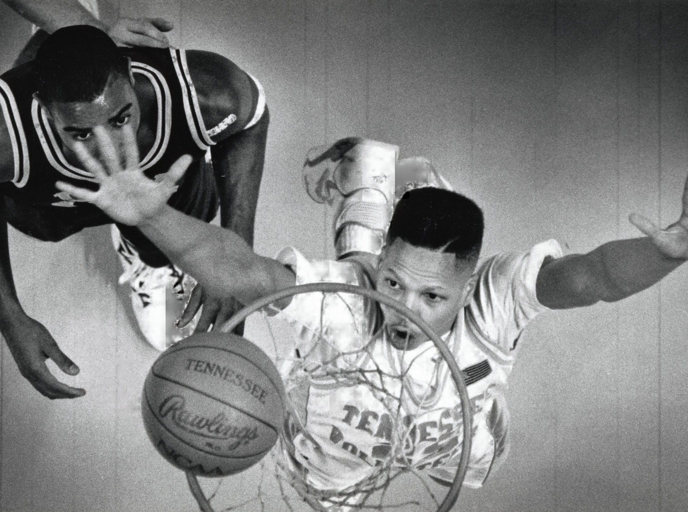 Tennessee's Steve Rivers makes sure the ball drops through the hoop after a rebound during a game in January 1991.