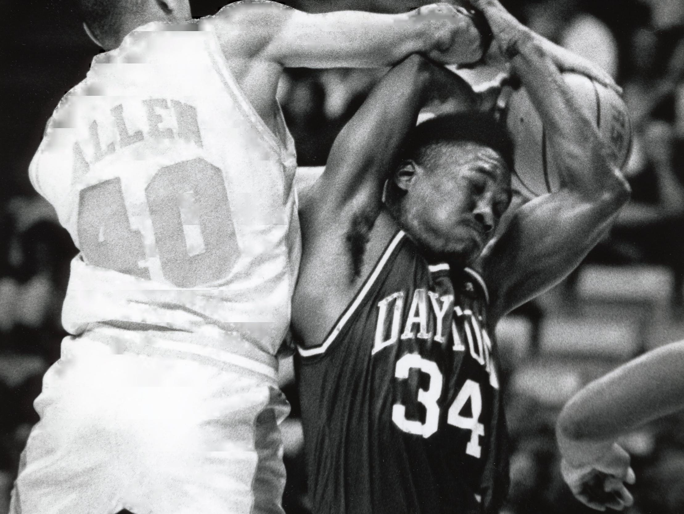 UT's Corey Allen, left, goes over the top of Dayton's Sean Scrutchins to get a hold of the rebound in February 1992.
