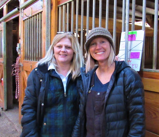 Executive director Tina McConnell and office manager Robin Hoffman are hands-on in the barn as well as the office.
