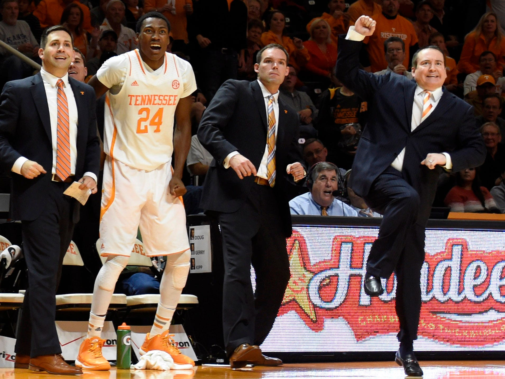 Tennessee assistant coach Beau Braden, left, Tennessee forward Willie Carmichael III (24), Tennessee assistant coach Chris Shumate and Tennessee coach Donnie Tyndall watch from the sideline during their NCAA college basketball game against Kansas State at Thompson-Boling Arena in Knoxville, Tenn., Saturday, Dec. 6, 2014.  Tennessee won 65-64.